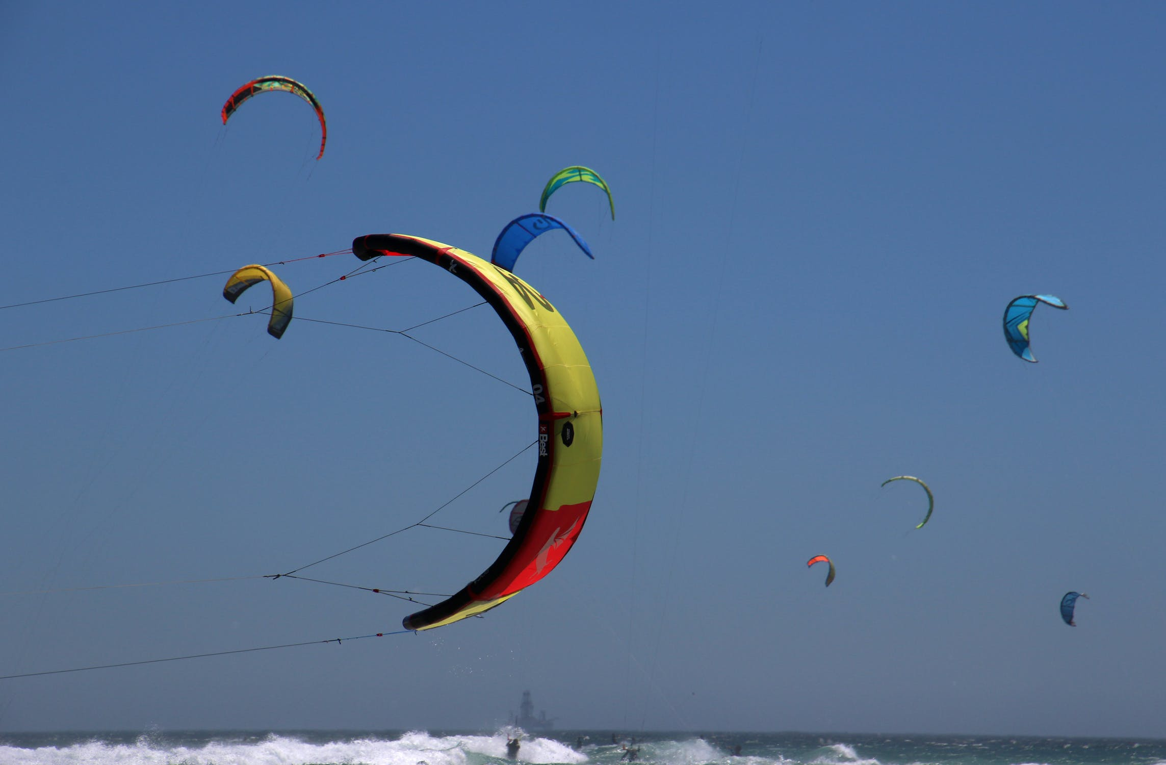 Paragliders flying in the sea photo