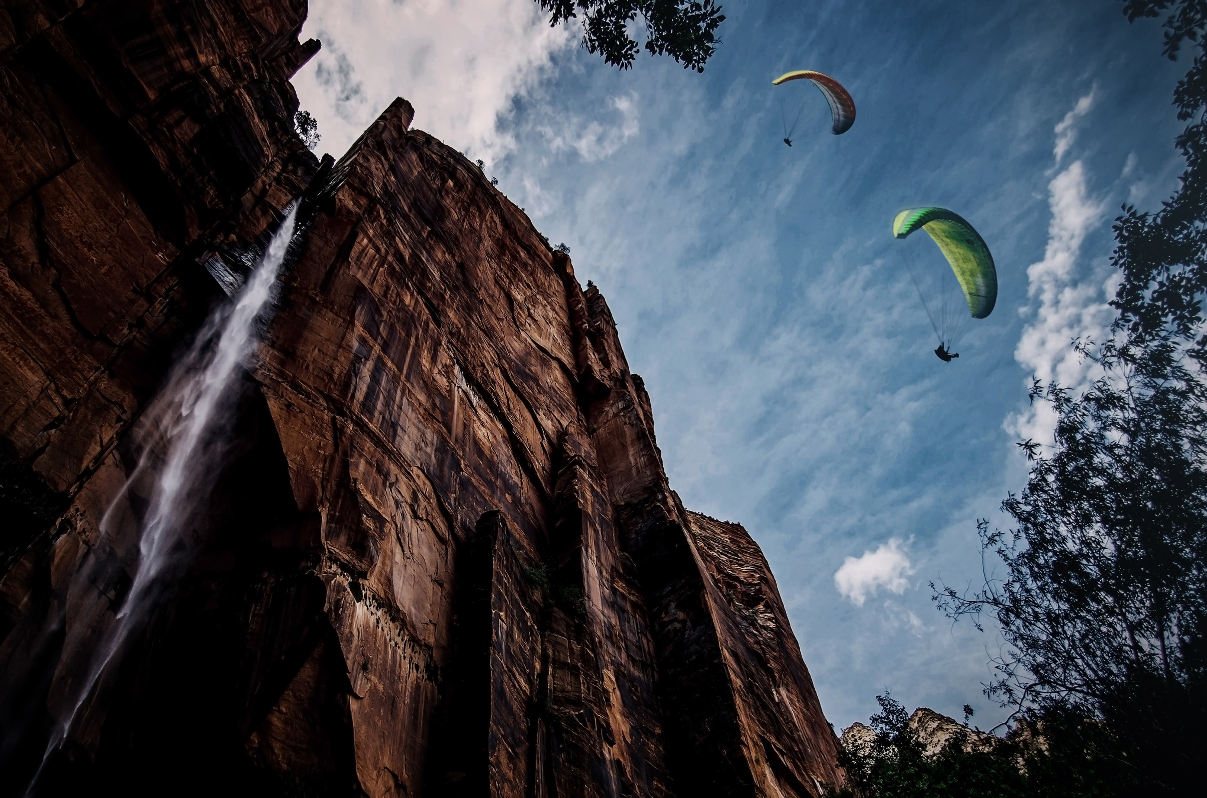 Paragliding over a waterfall photo