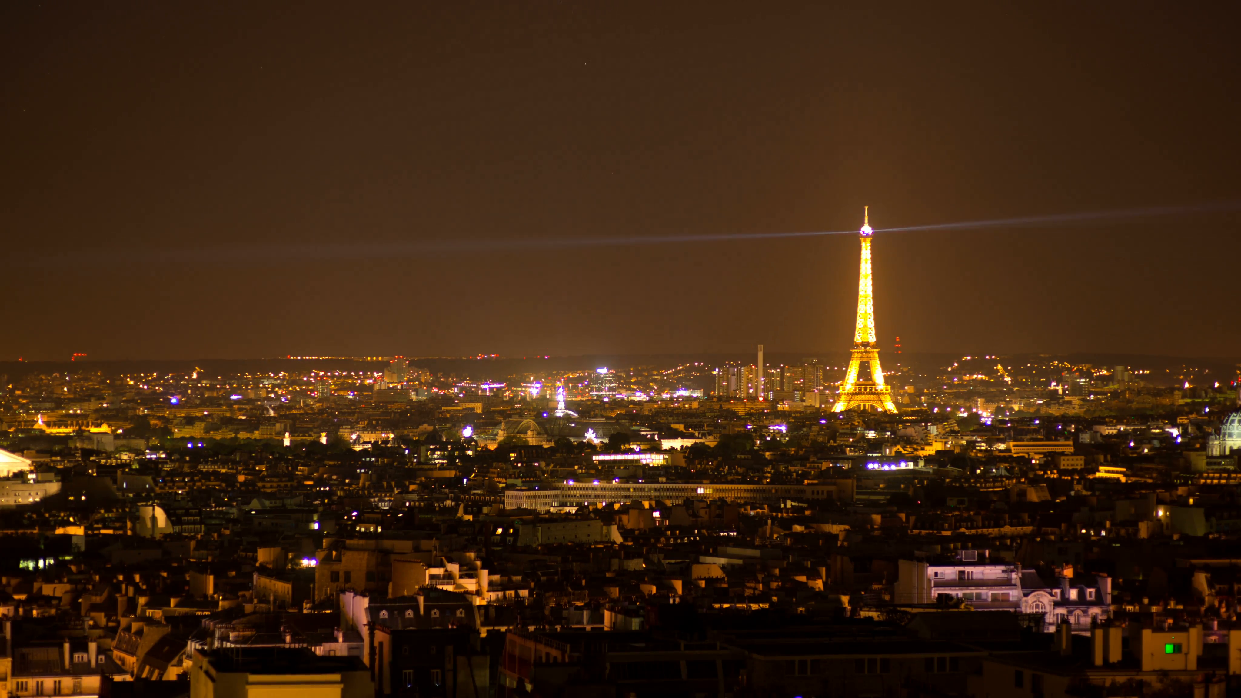 timelapse of the paris skyline at ngiht with the bright laser beam ...