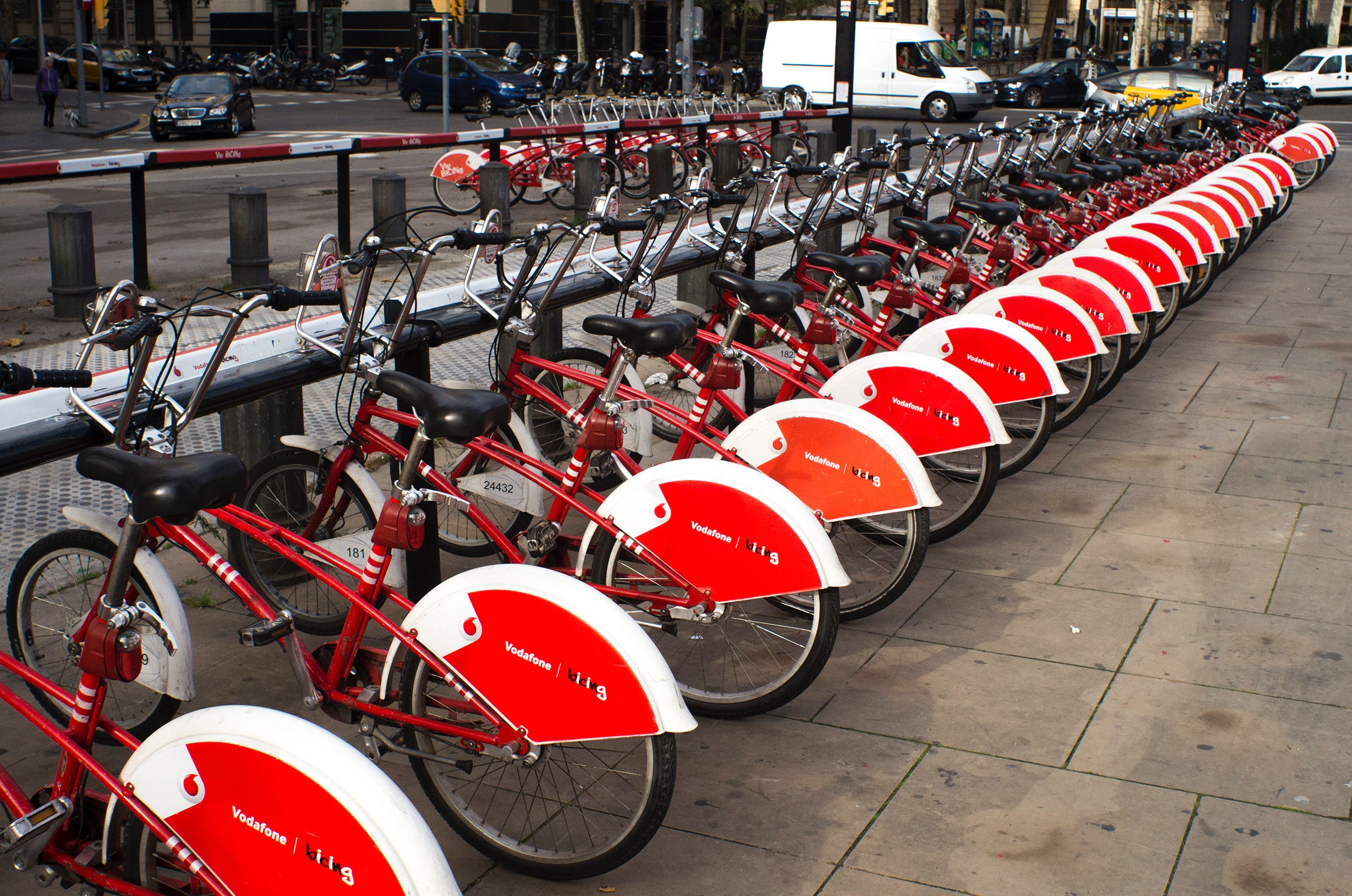 Parked red and white bicycles photo
