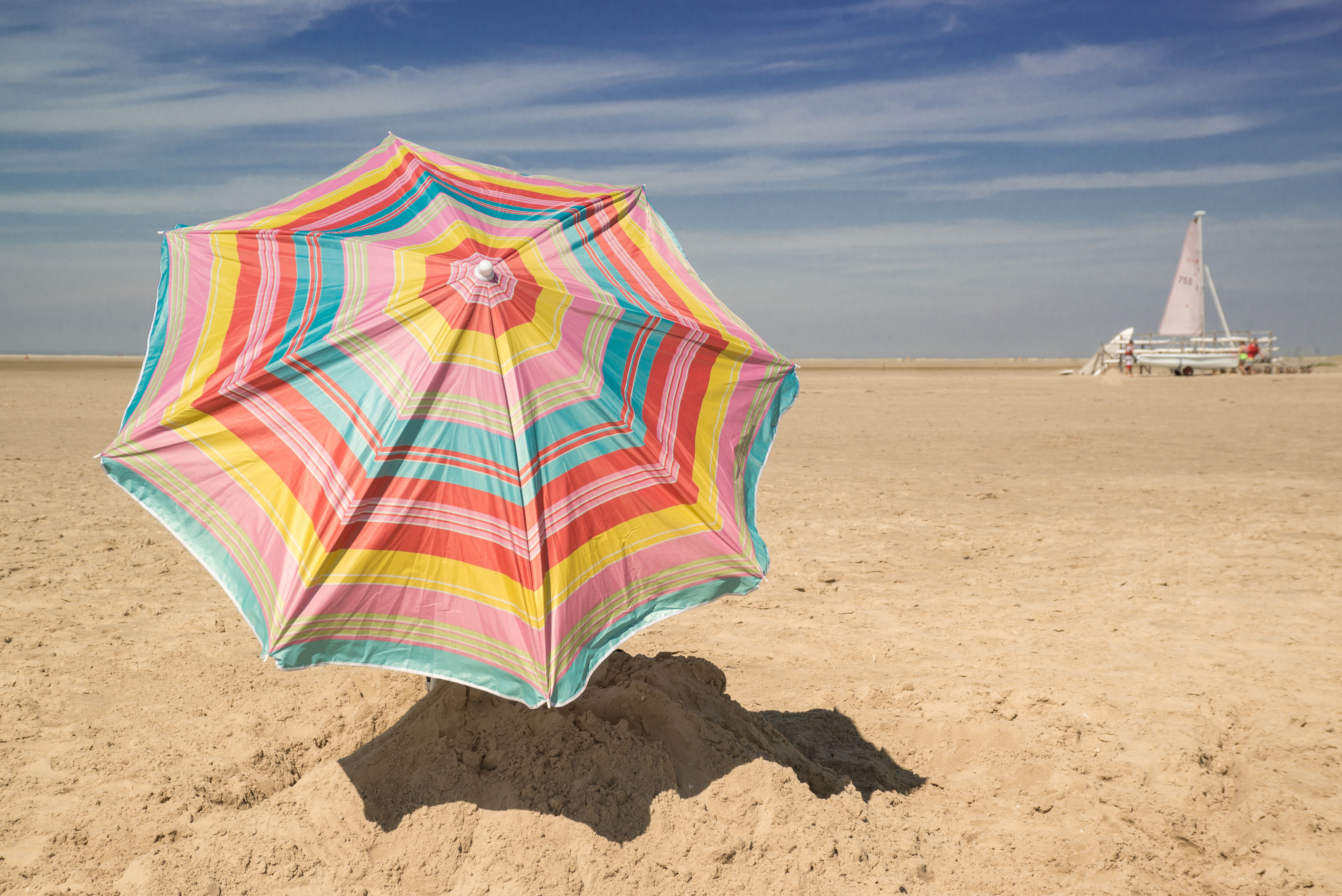 Patio umbrella on sand photo