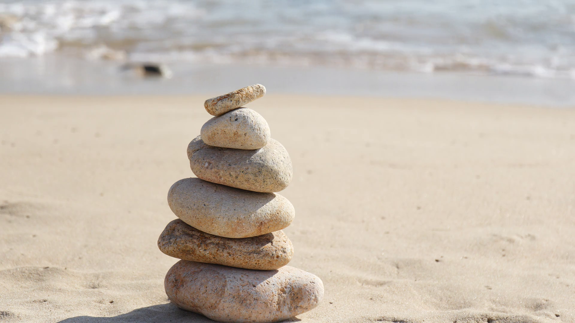 Hand putting the pebble stone on balance zen stock Stock Video ...