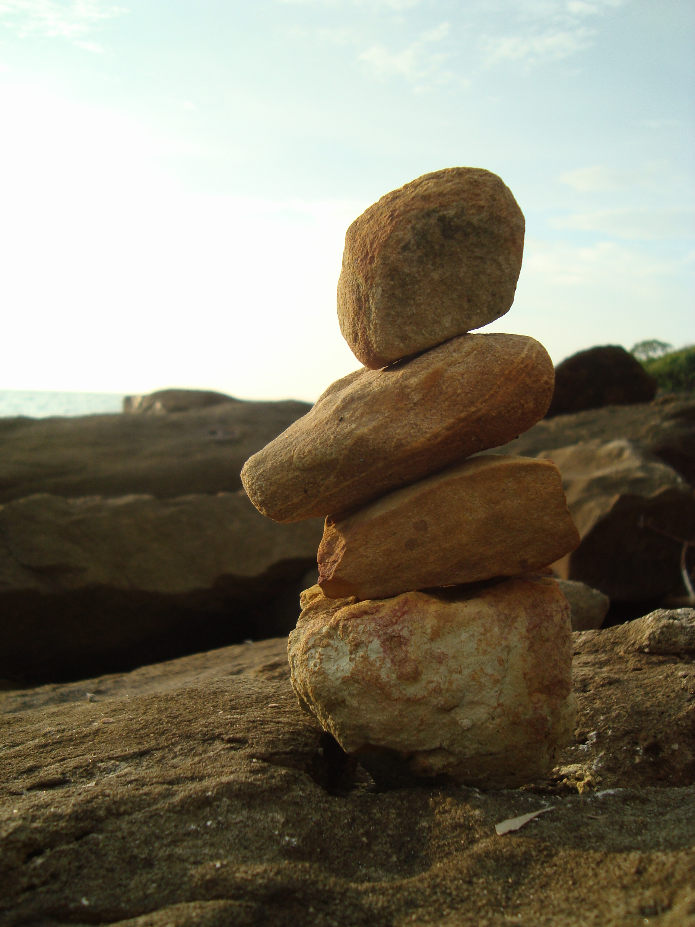 Pebble balance by the sea photo