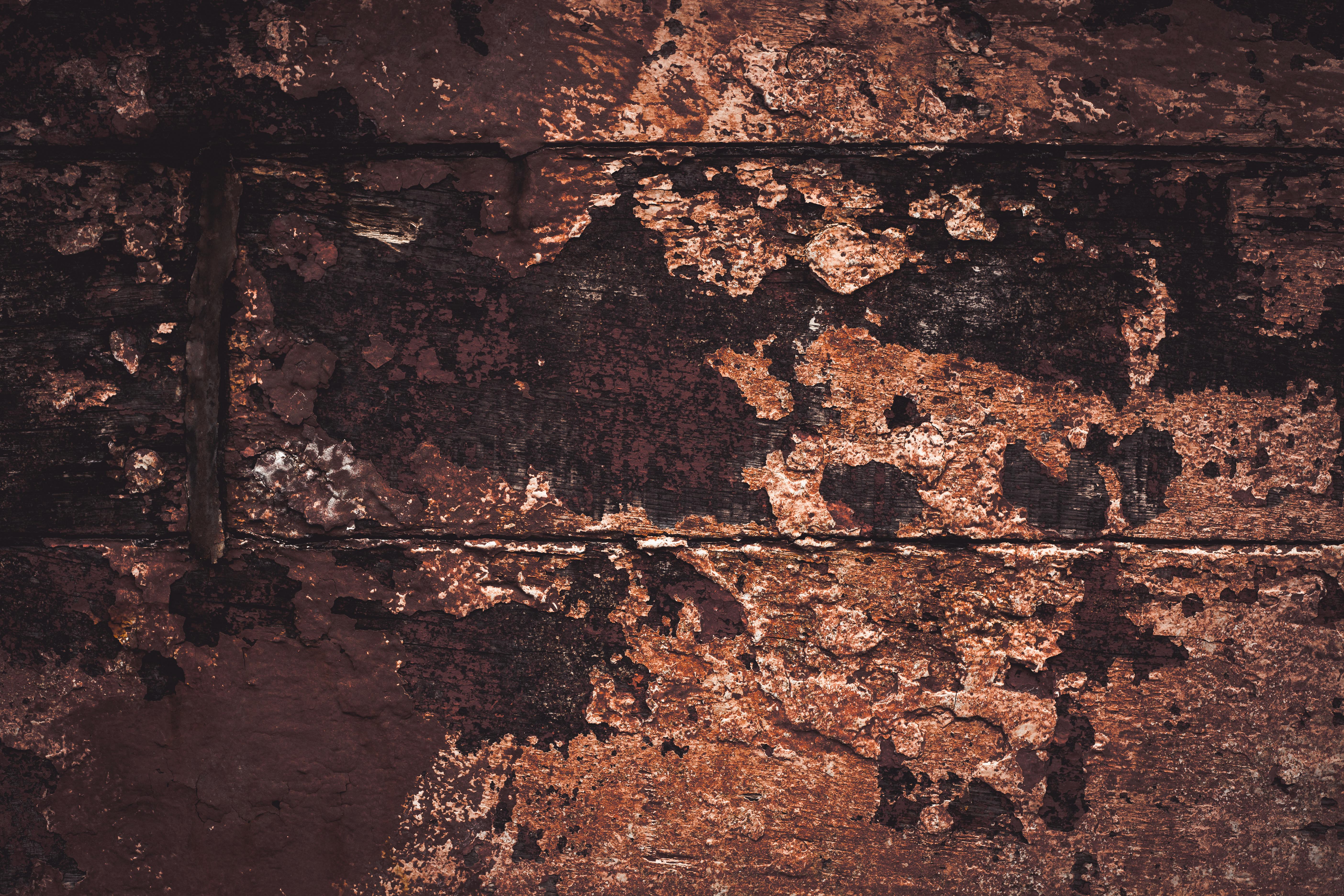 Peeled paint on grunge wood texture photo