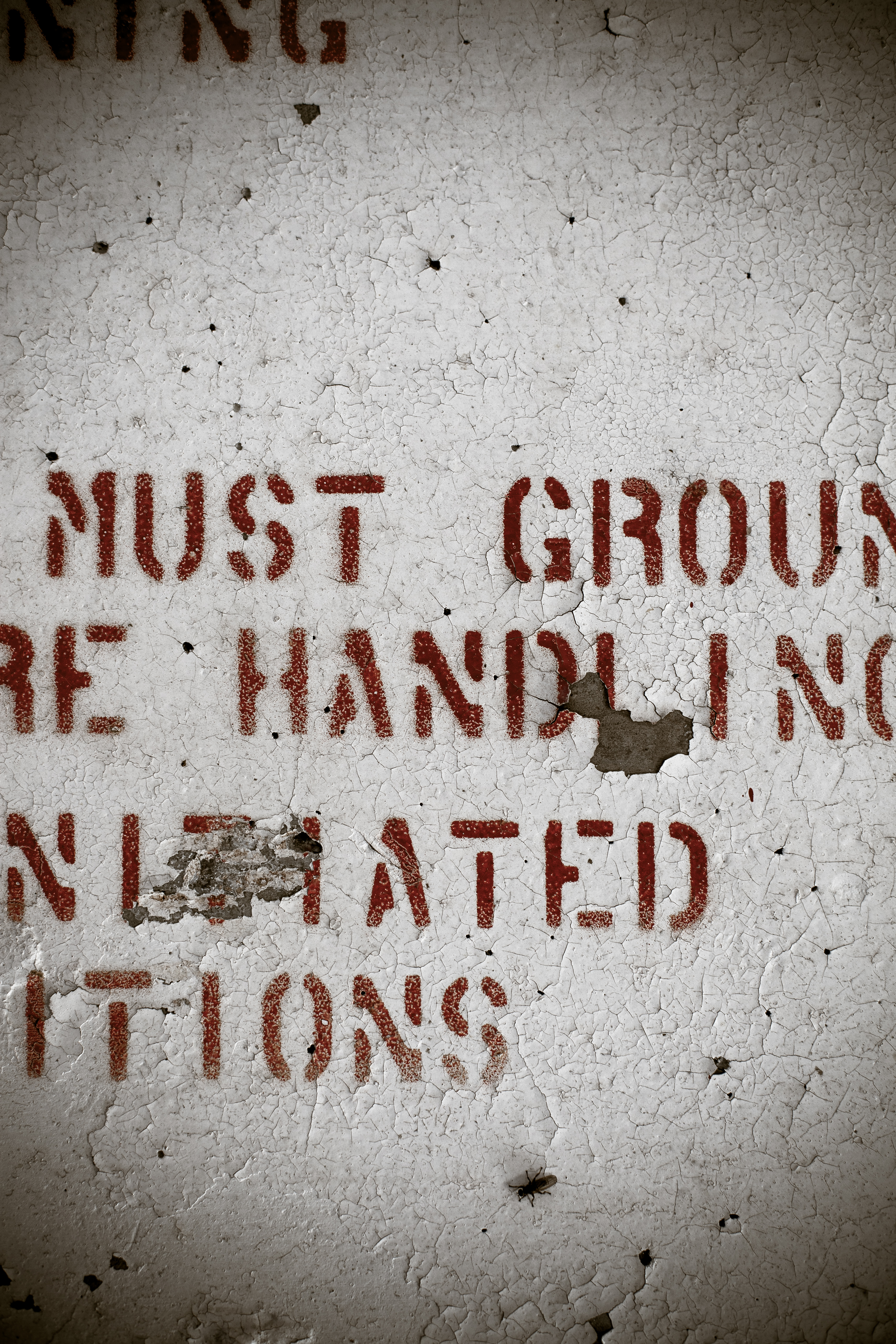 Peeling wall with red text photo