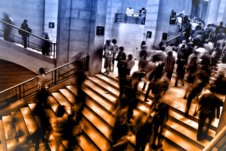 People at underground subway station climbing stairs - blurry looks photo