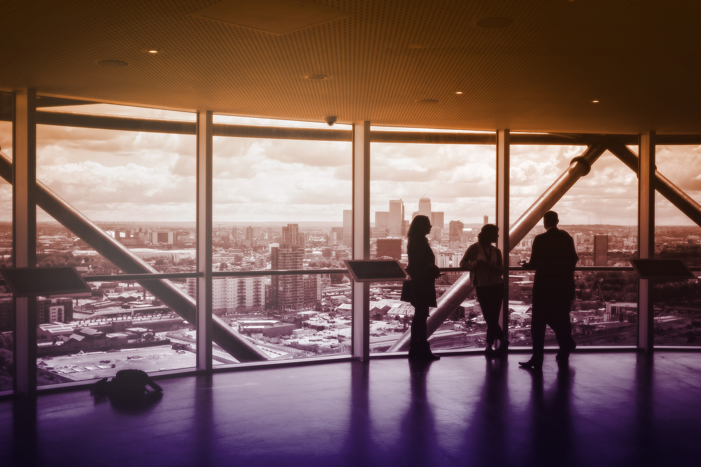 People enjoying the view and discussing business photo