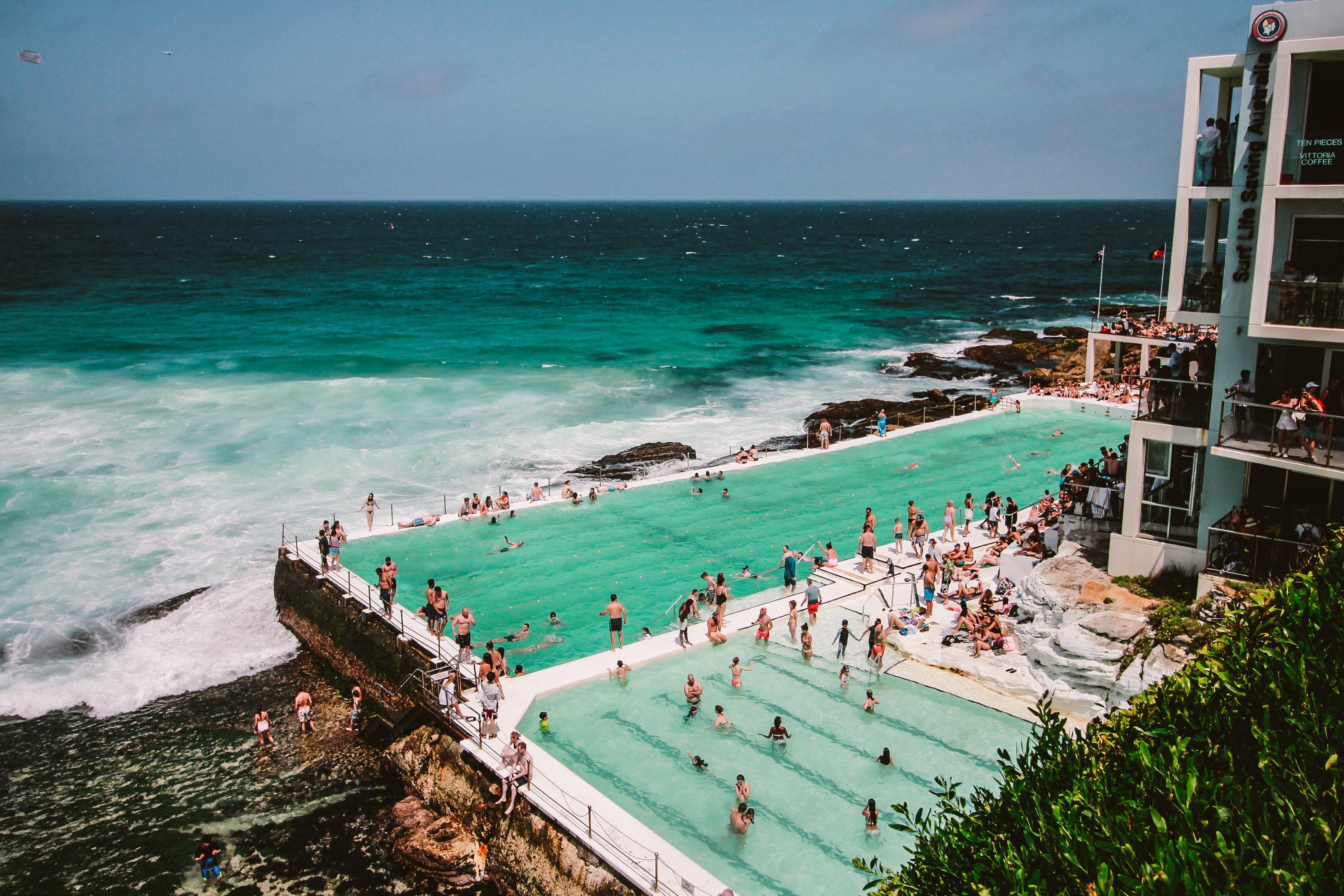 People gathering near swimming pool photo