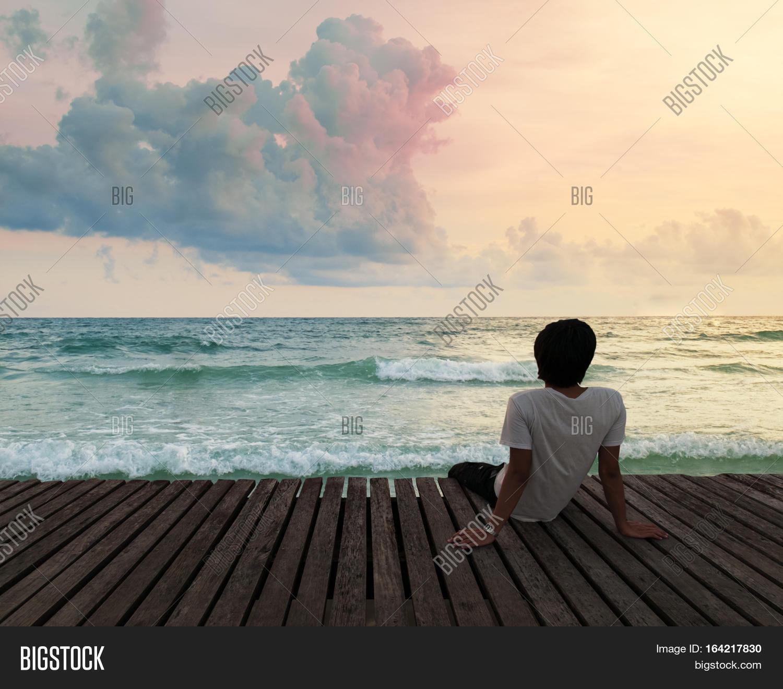 Lonely Man Sitting Wooden Dock Pier Image & Photo   Bigstock
