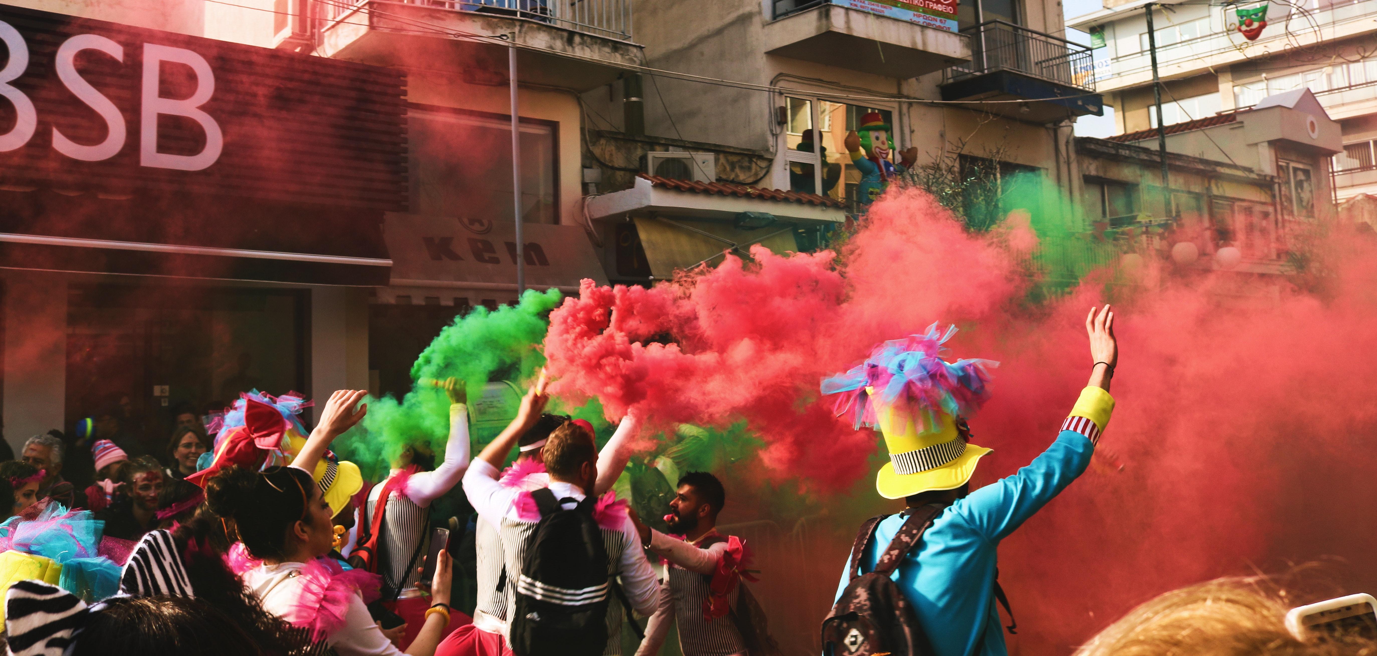 People spraying assorted color of smoke photo