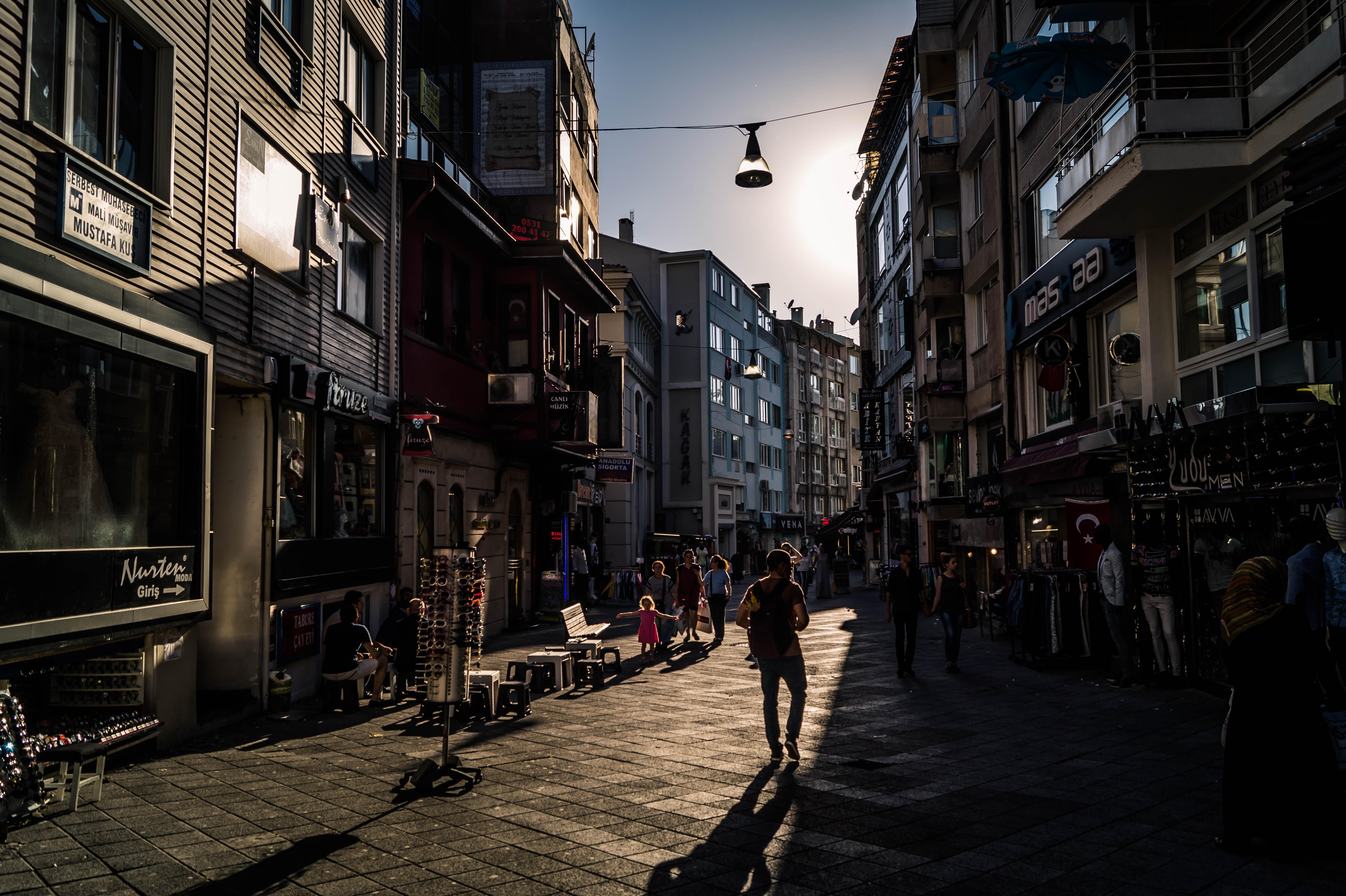 People walking on street between high rise building photo