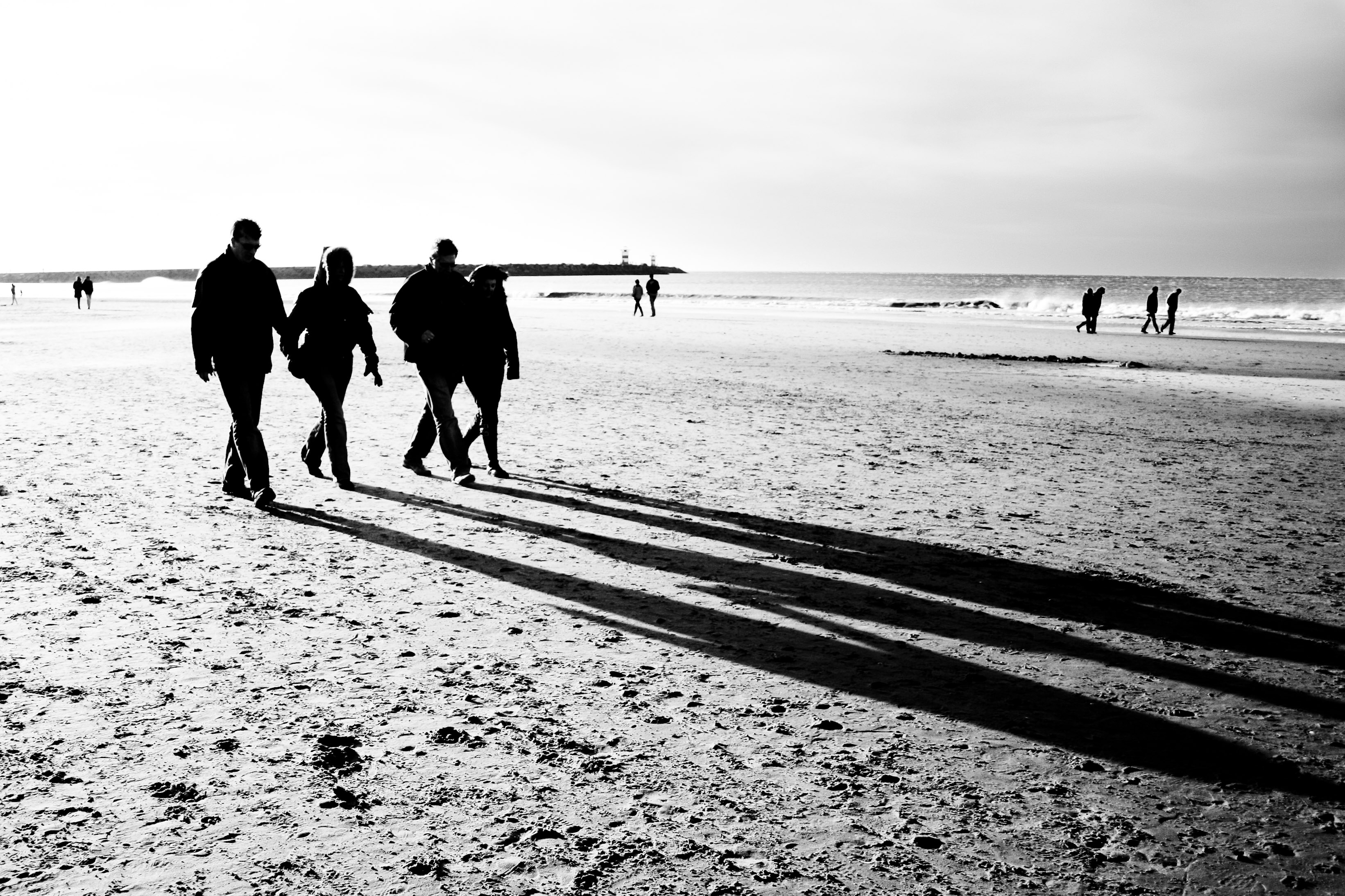 People walking on the beach photo