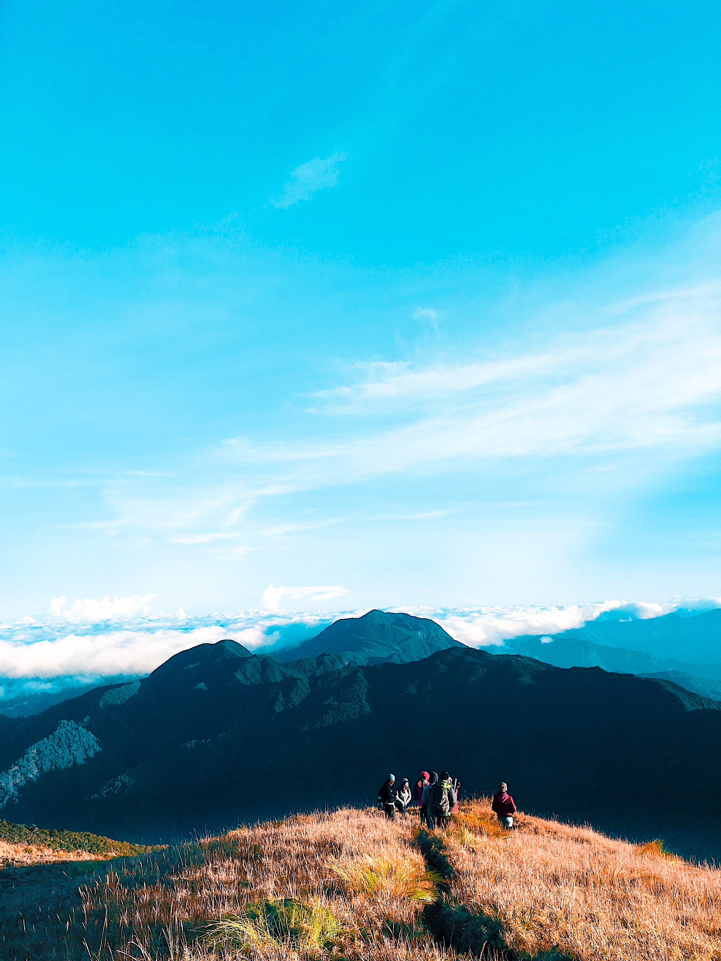 People walking on top of mountain photo
