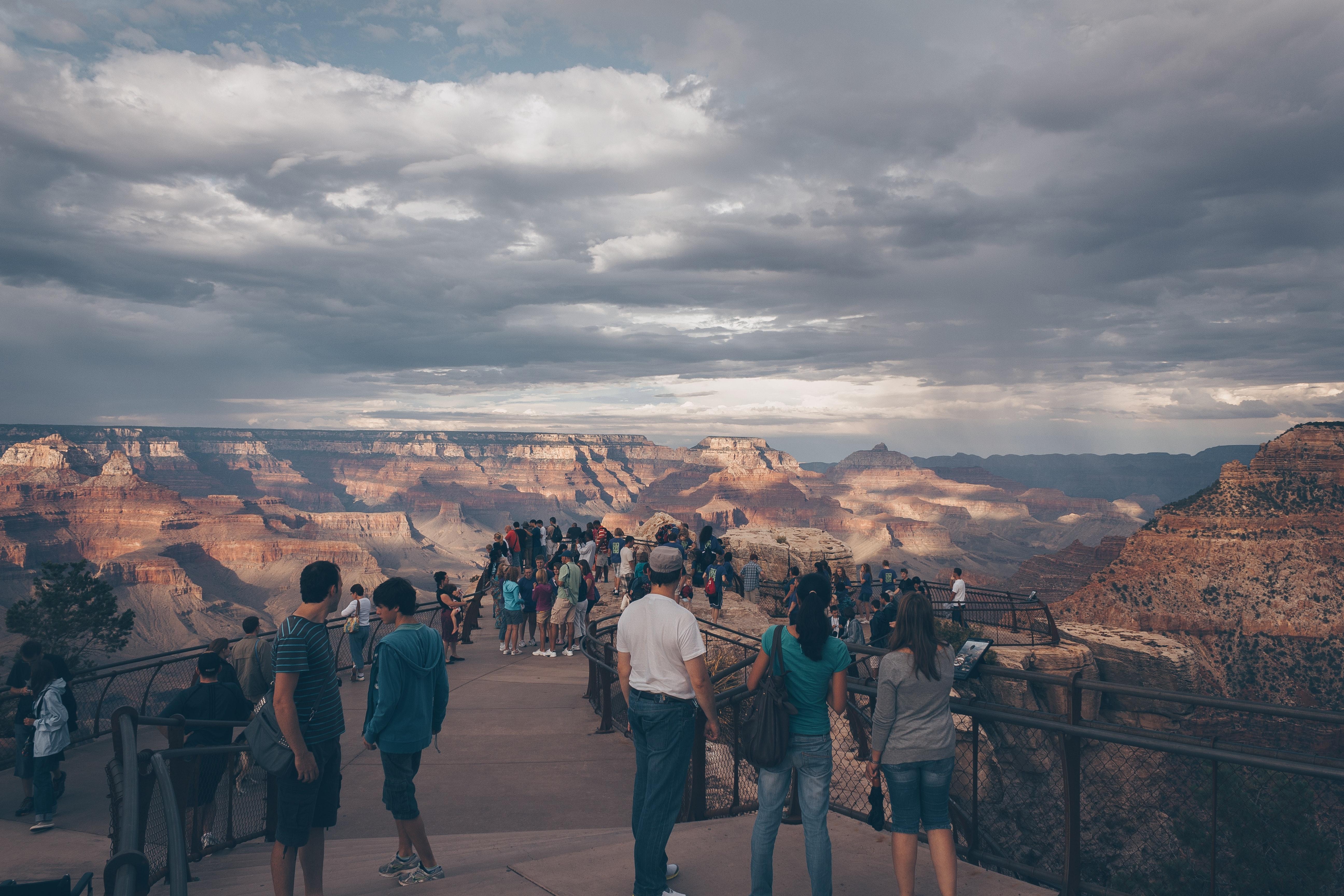 People watching mountain at daytime photo