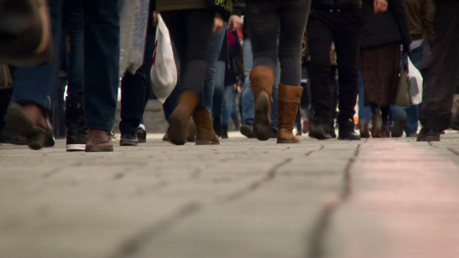 City People Walking on the Sidewalk. Individuals Wearing Jeans ...