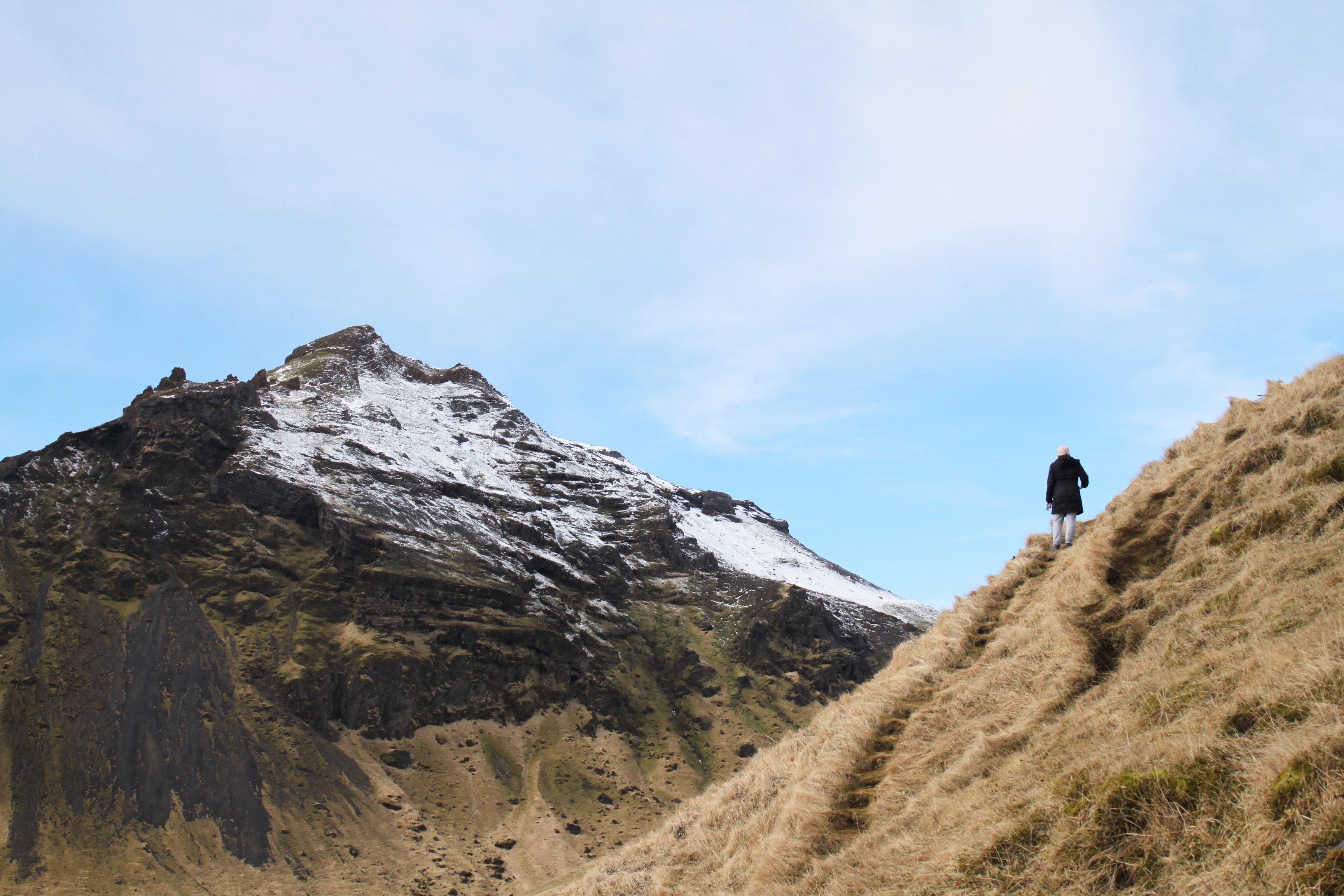 Person climb on mountain photo