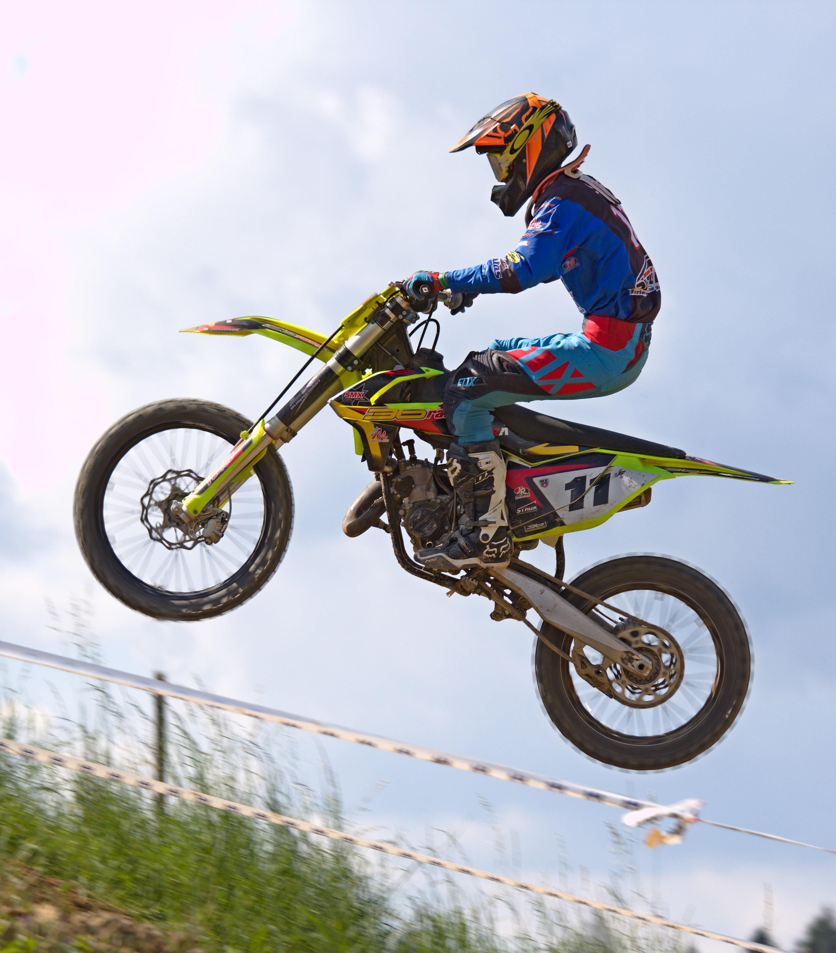 Person doing stunt in motocross dirt bike photo