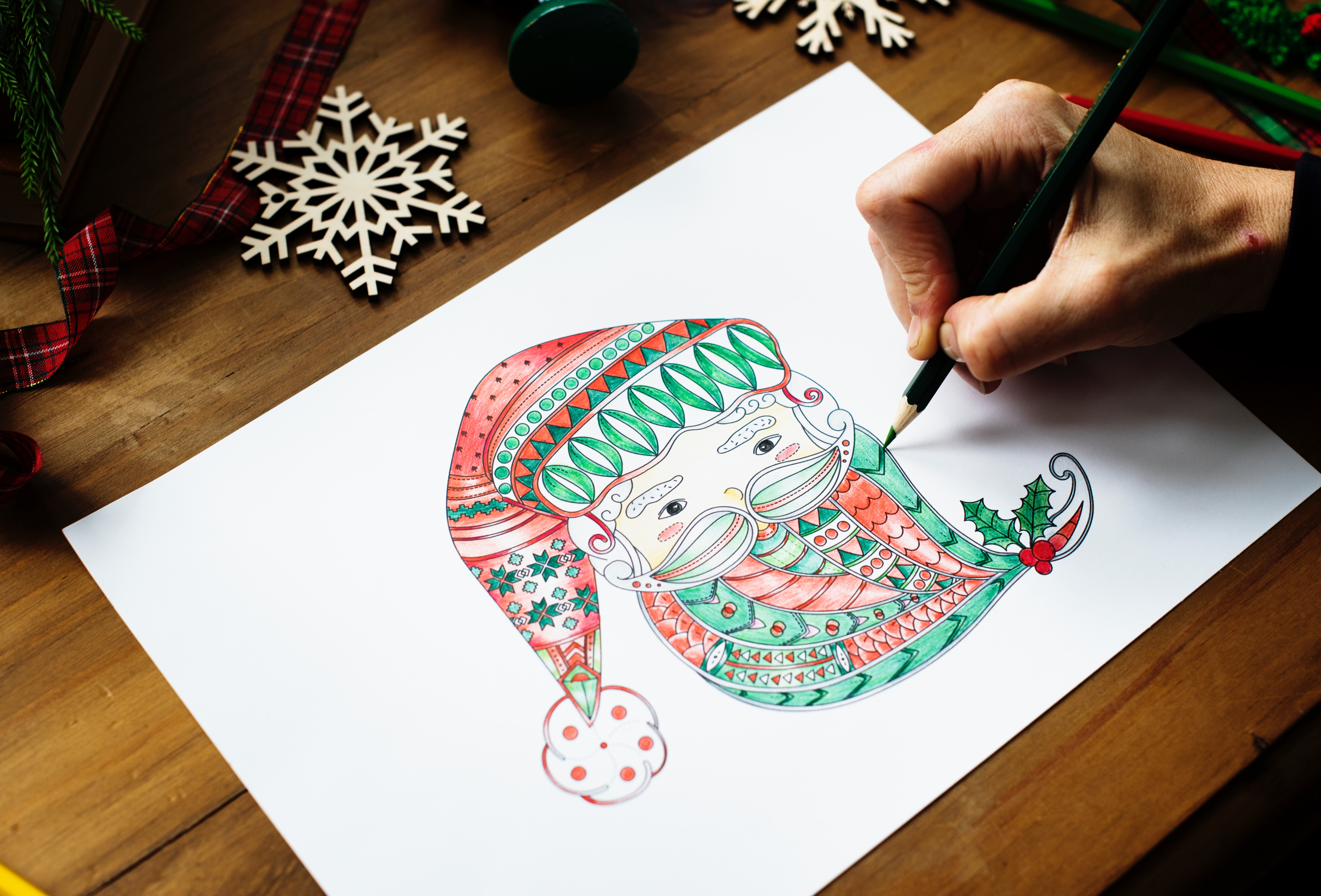 Person drawing gnome on white printer paper photo