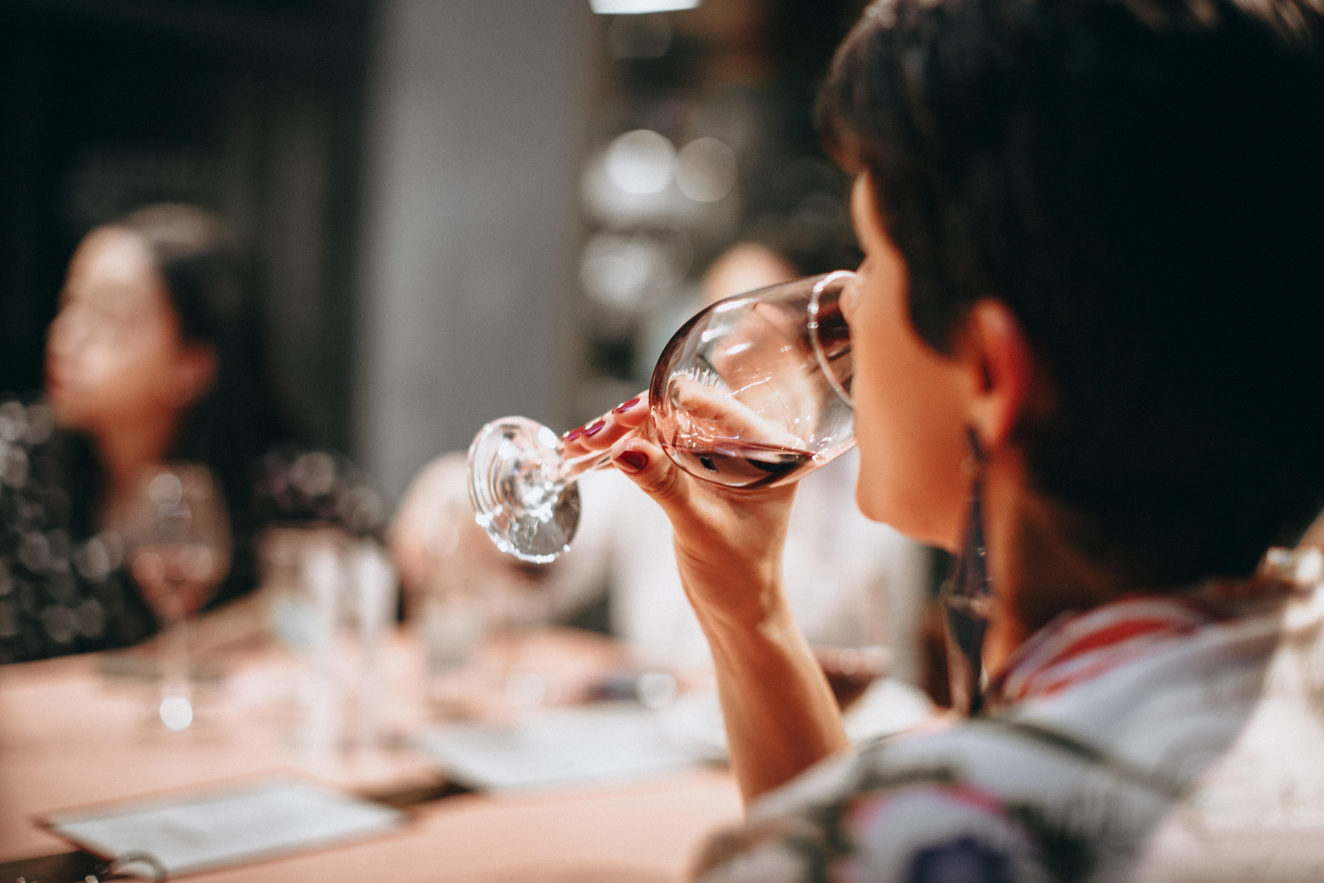 Person drinking wine photo