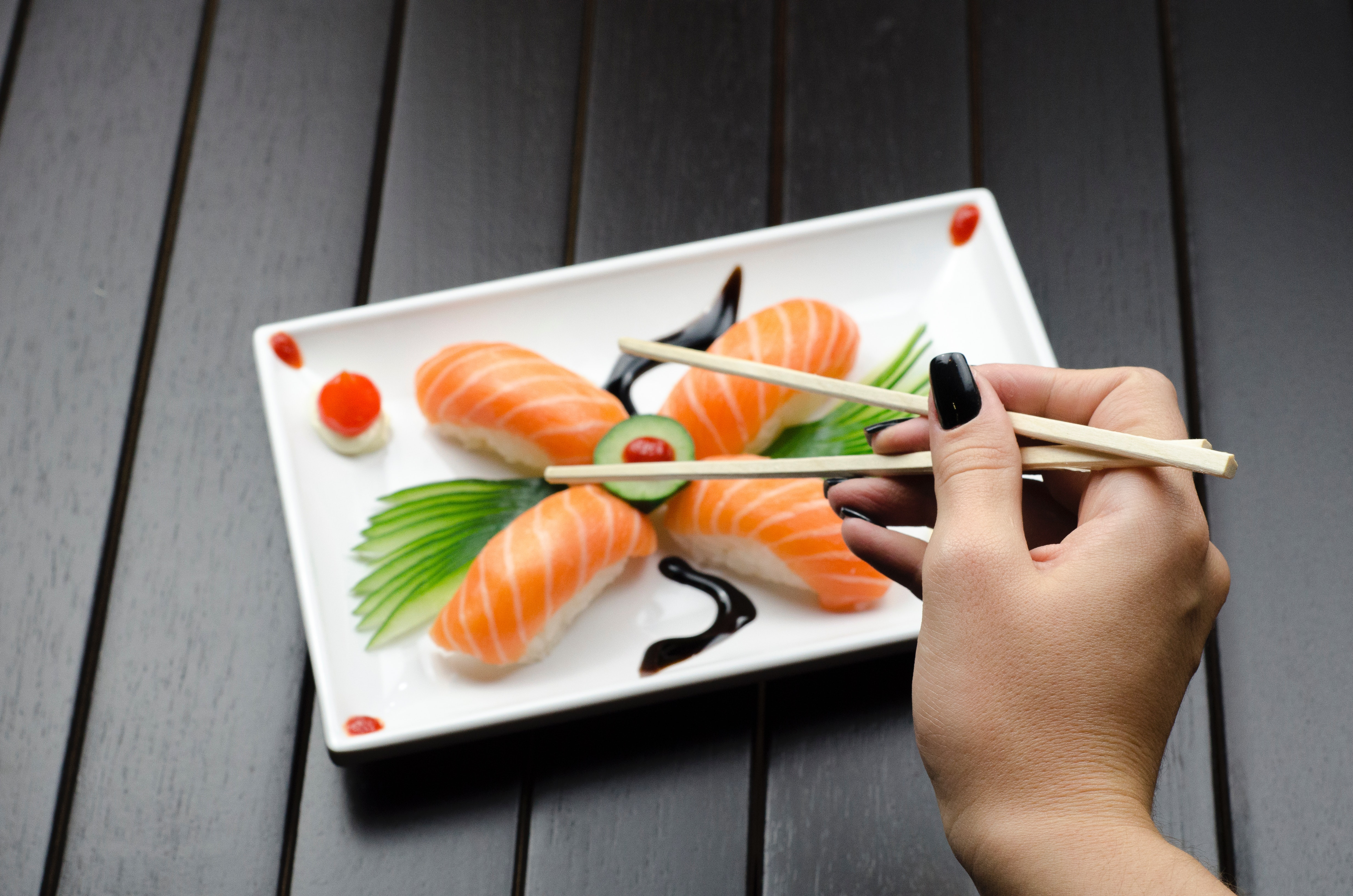 Person eating sushi photo