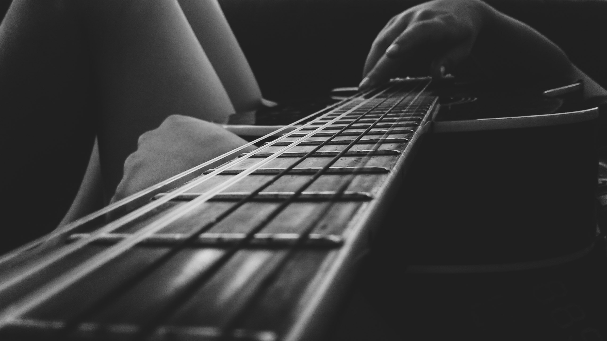 Person holding an acoustic guitar photo
