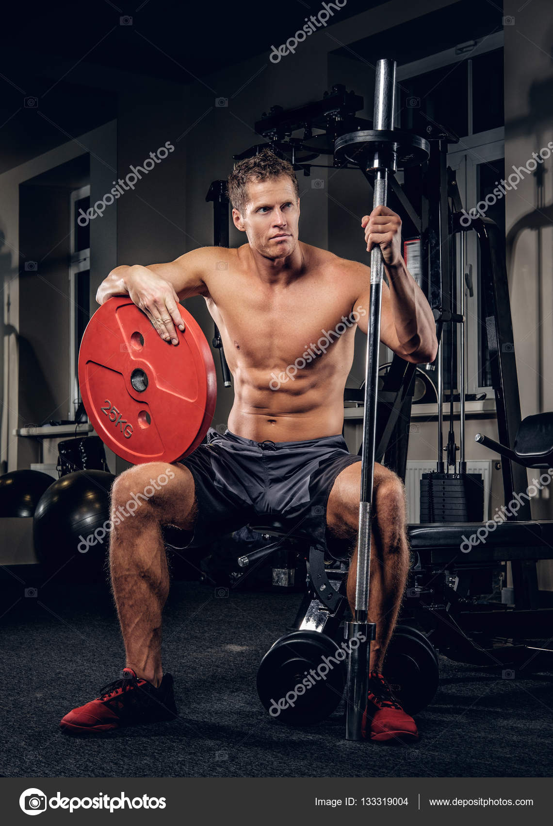 Muscular man holding barbell weight — Stock Photo © fxquadro #133319004