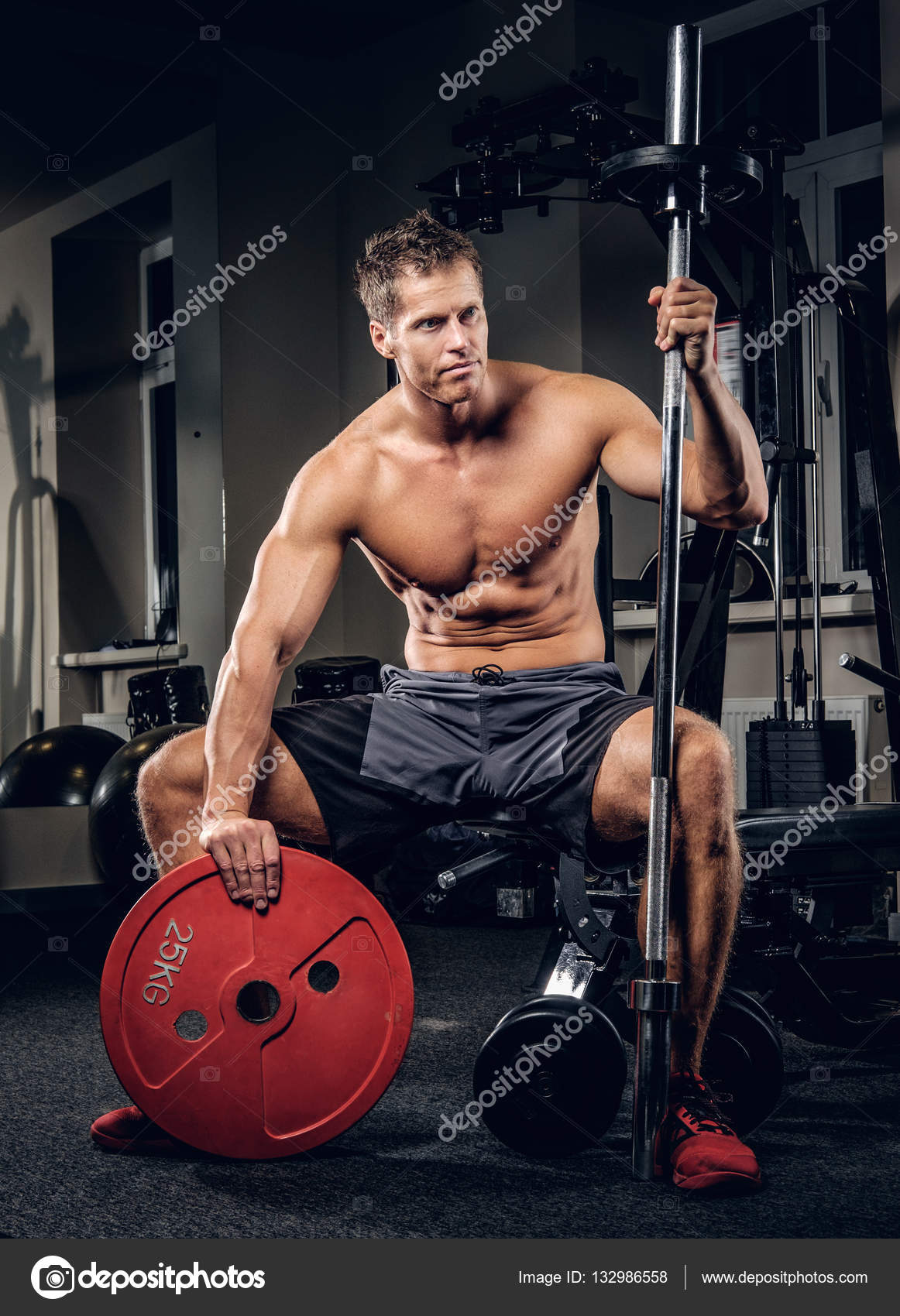 Muscular man holding barbell weight — Stock Photo © fxquadro #132986558