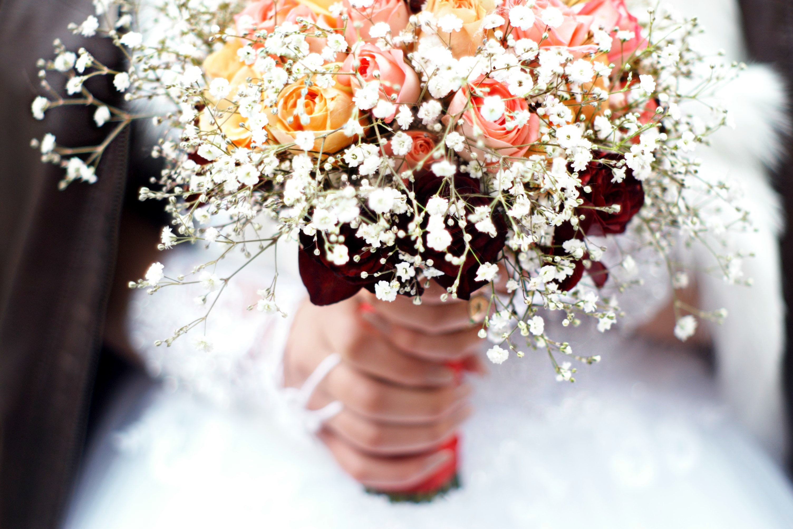 Person holding bouquet of flower photo