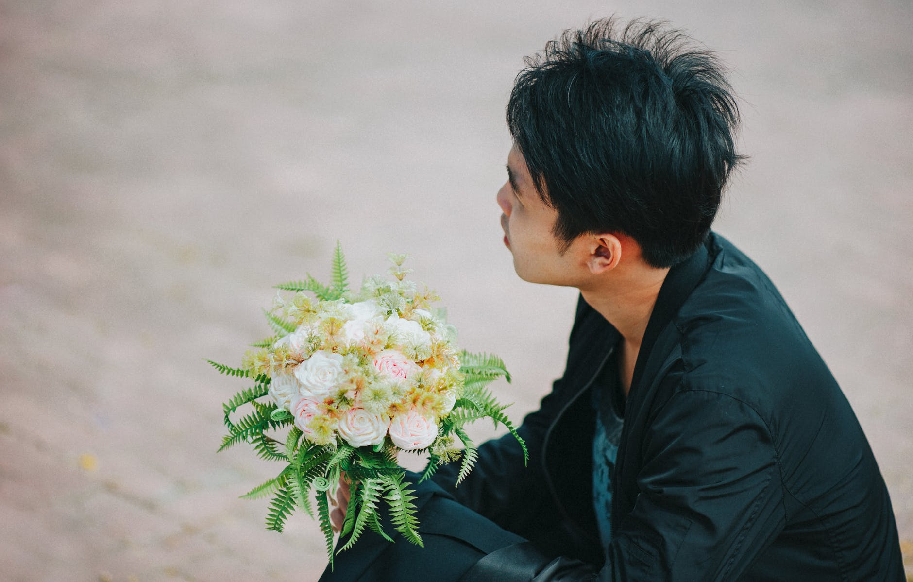 Person holding bouquet of roses photo