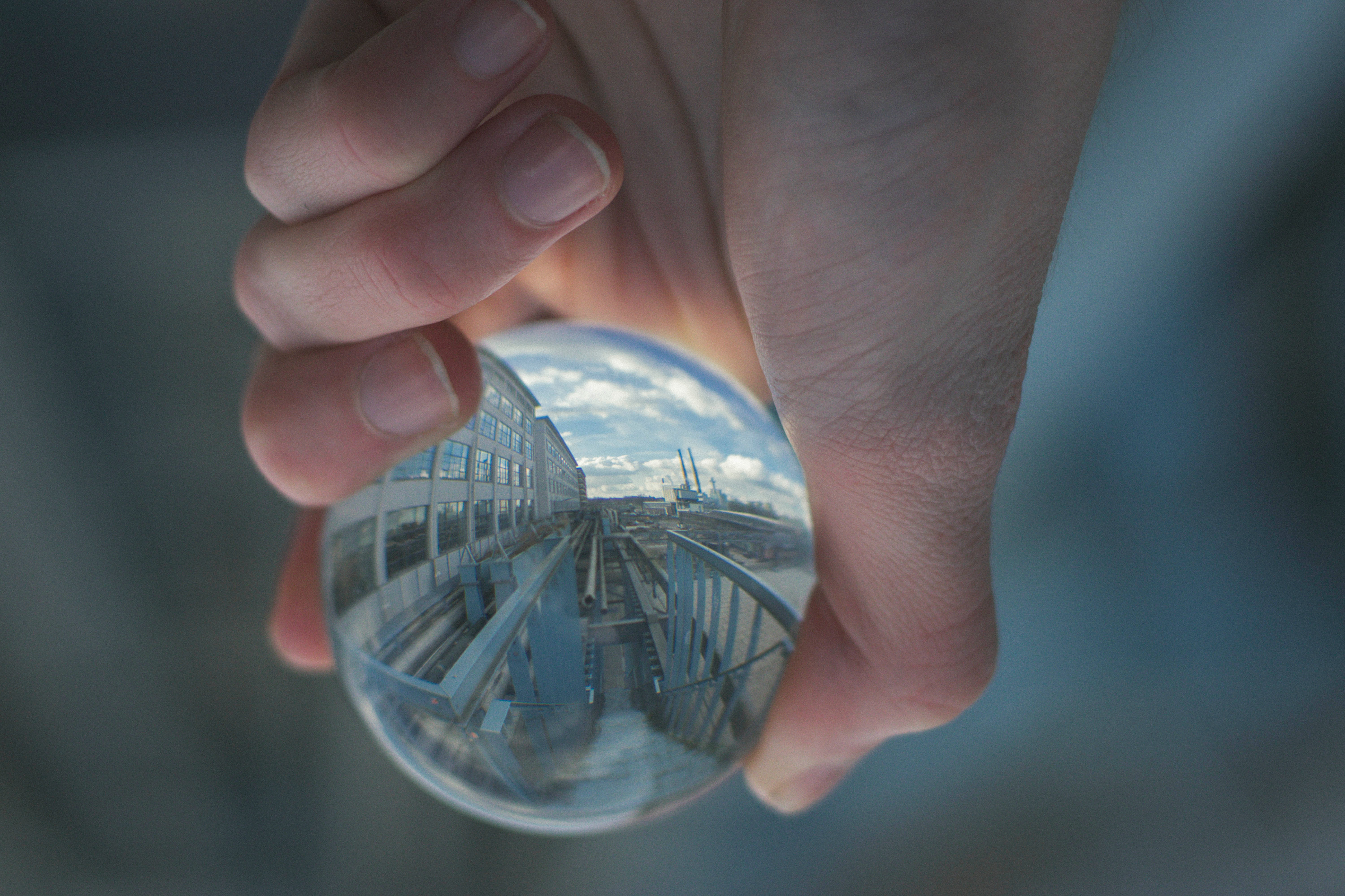 Person holding clear glass decor photo