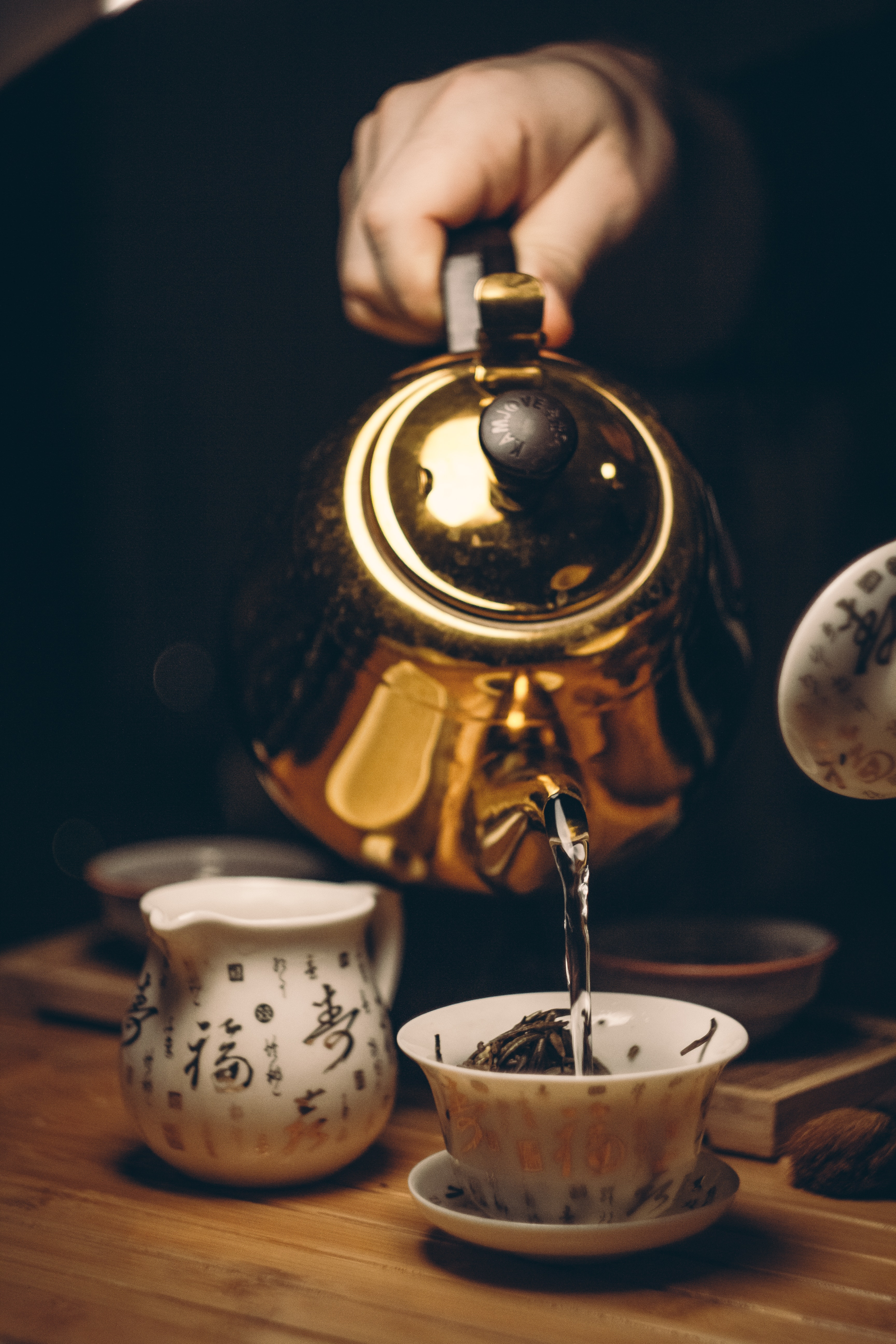 Person Holding Gold Teapot Pouring White Ceramic Teacup, Beverage, Pot, Vintage, Traditional, HQ Photo