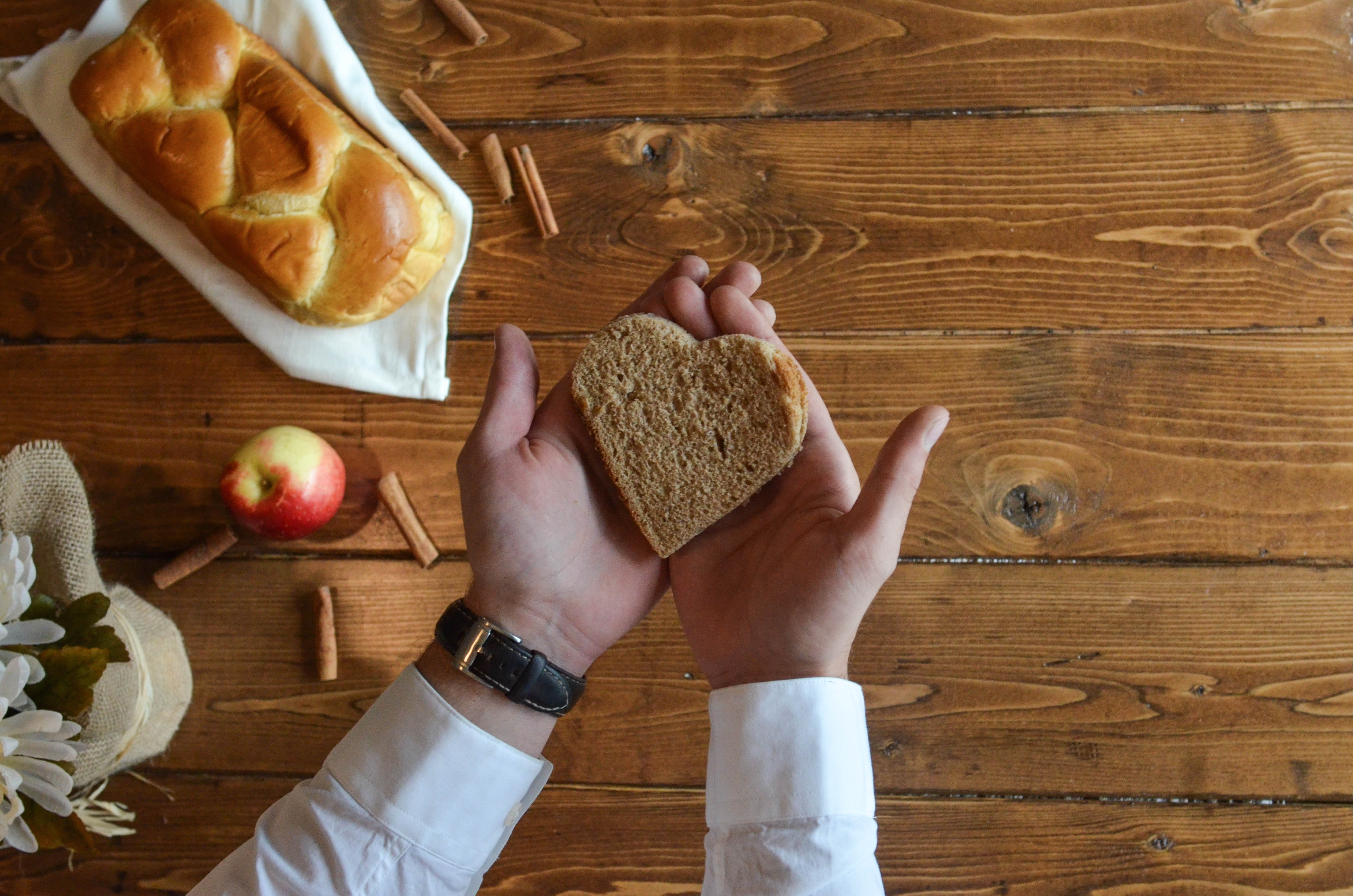Person holding heart shaped bread photo