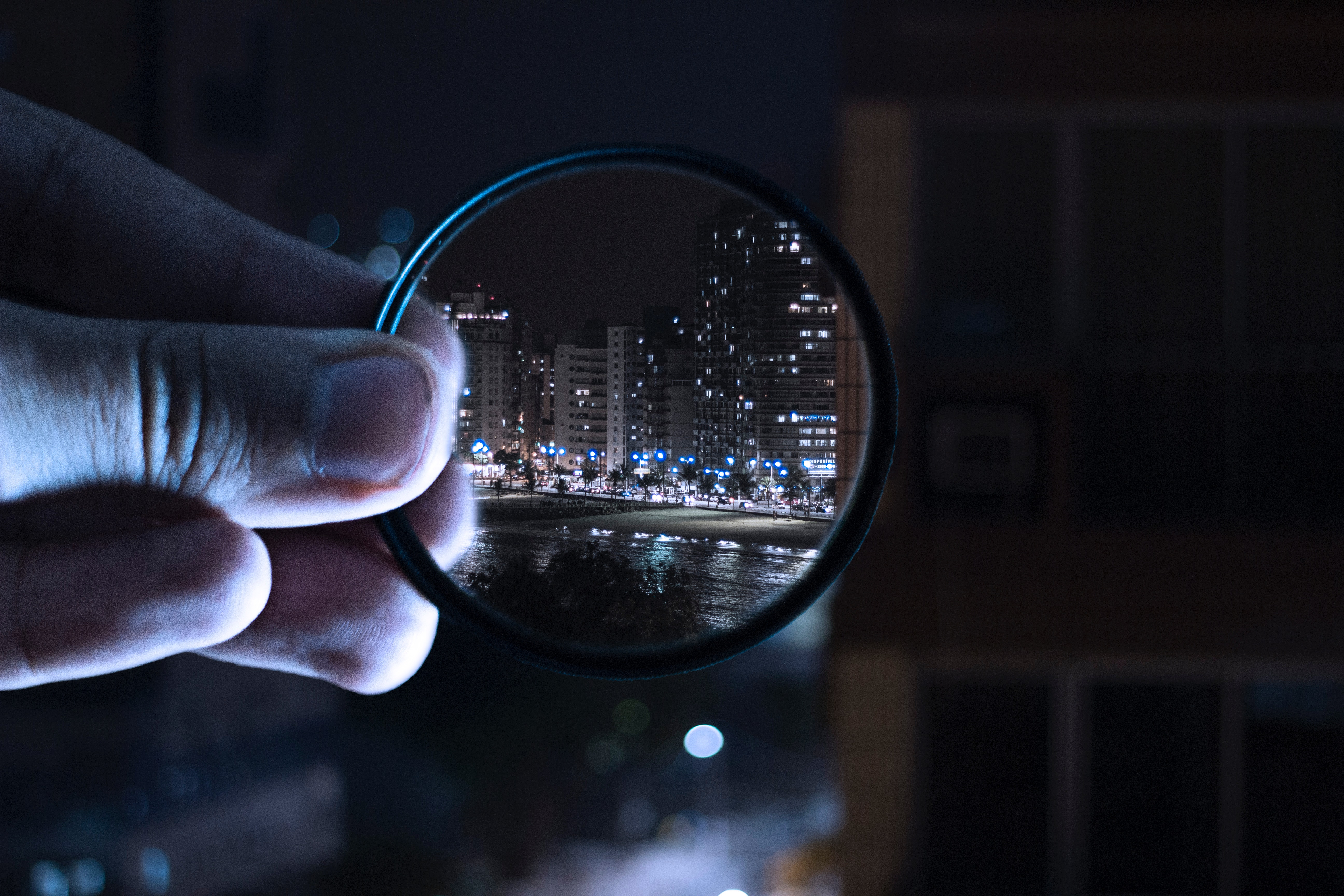 Person holding magnifying glass photo