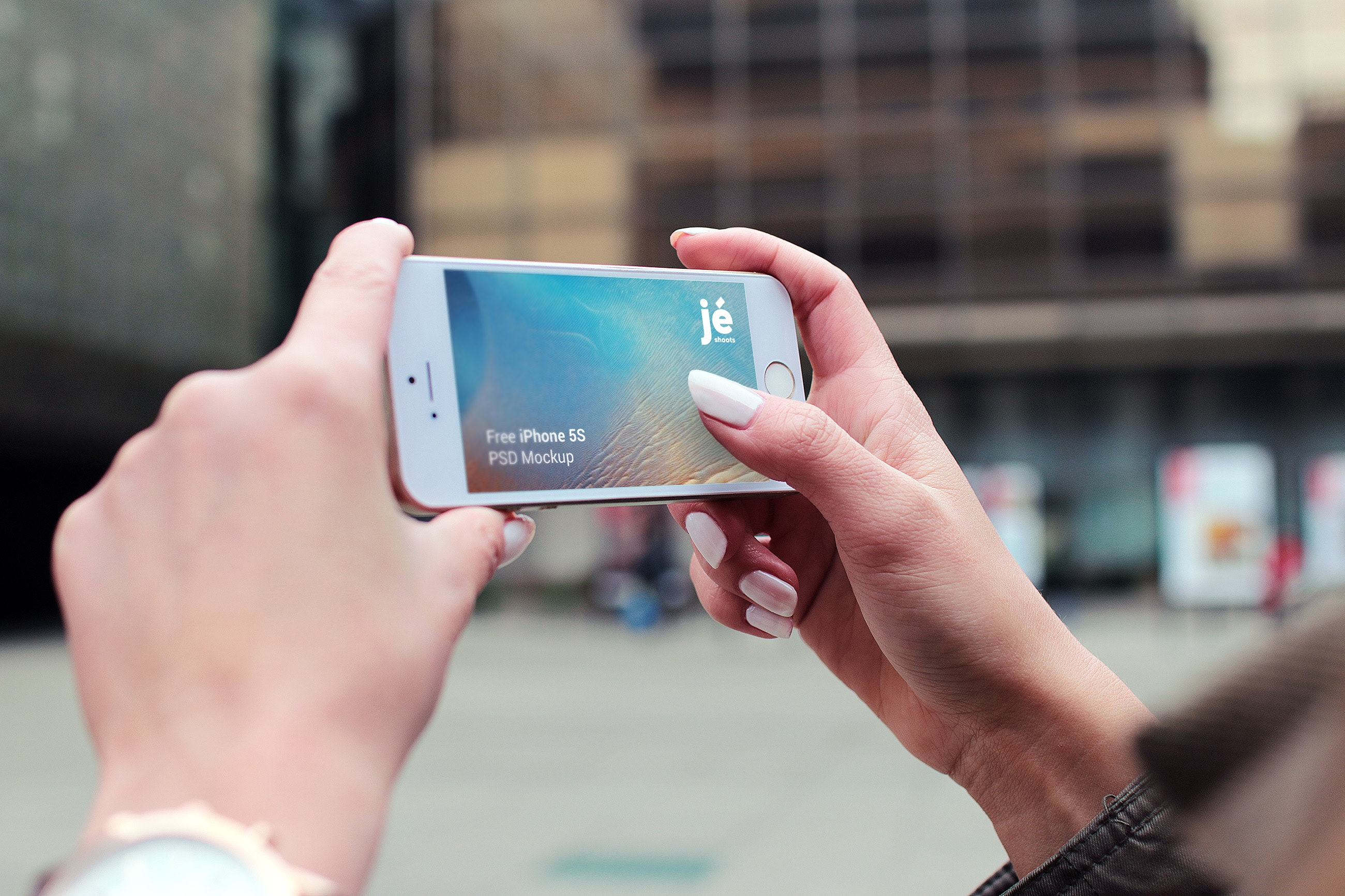 Person holding silver iphone 5s photo