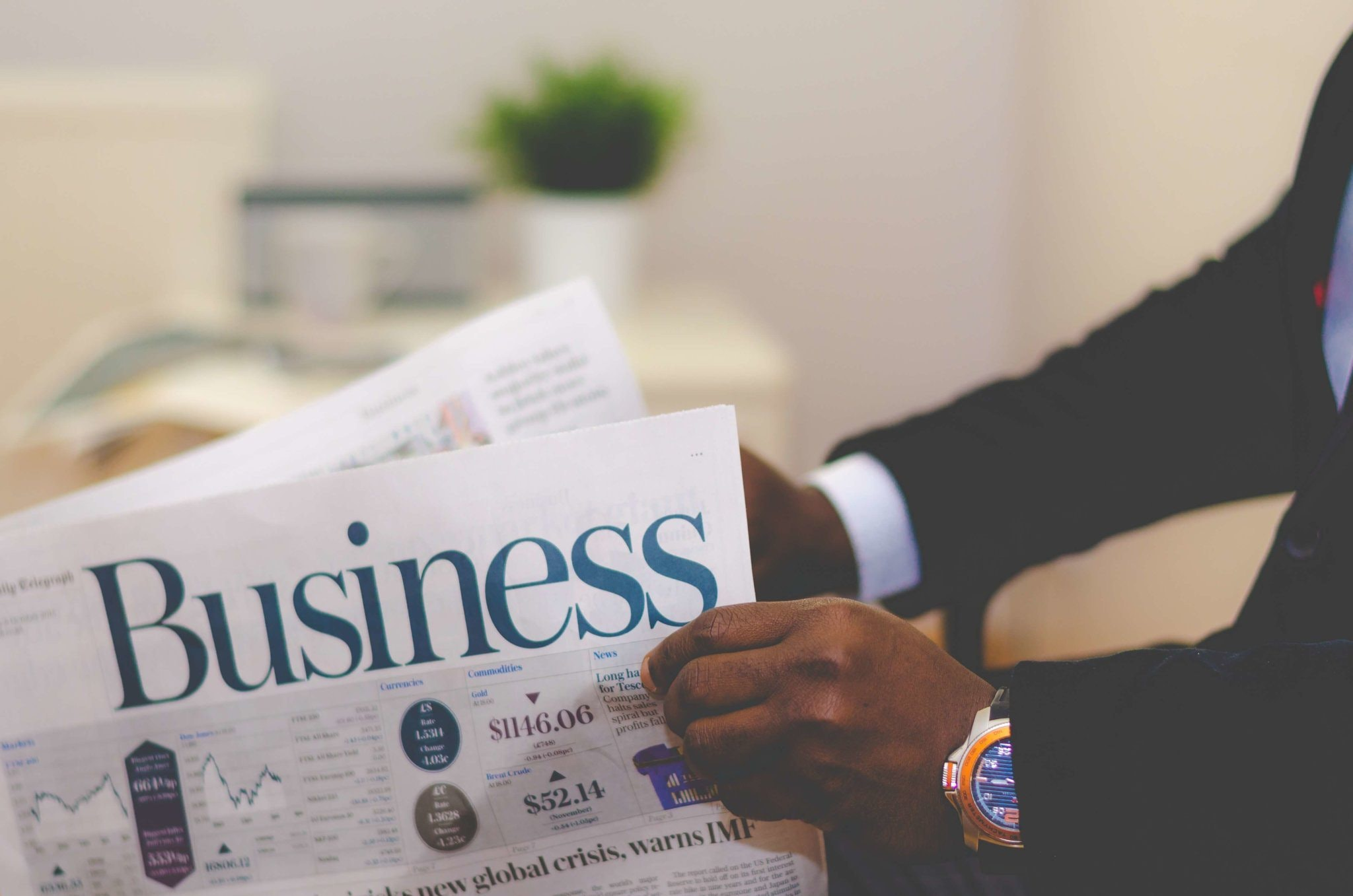 Person holding white and blue business paper photo