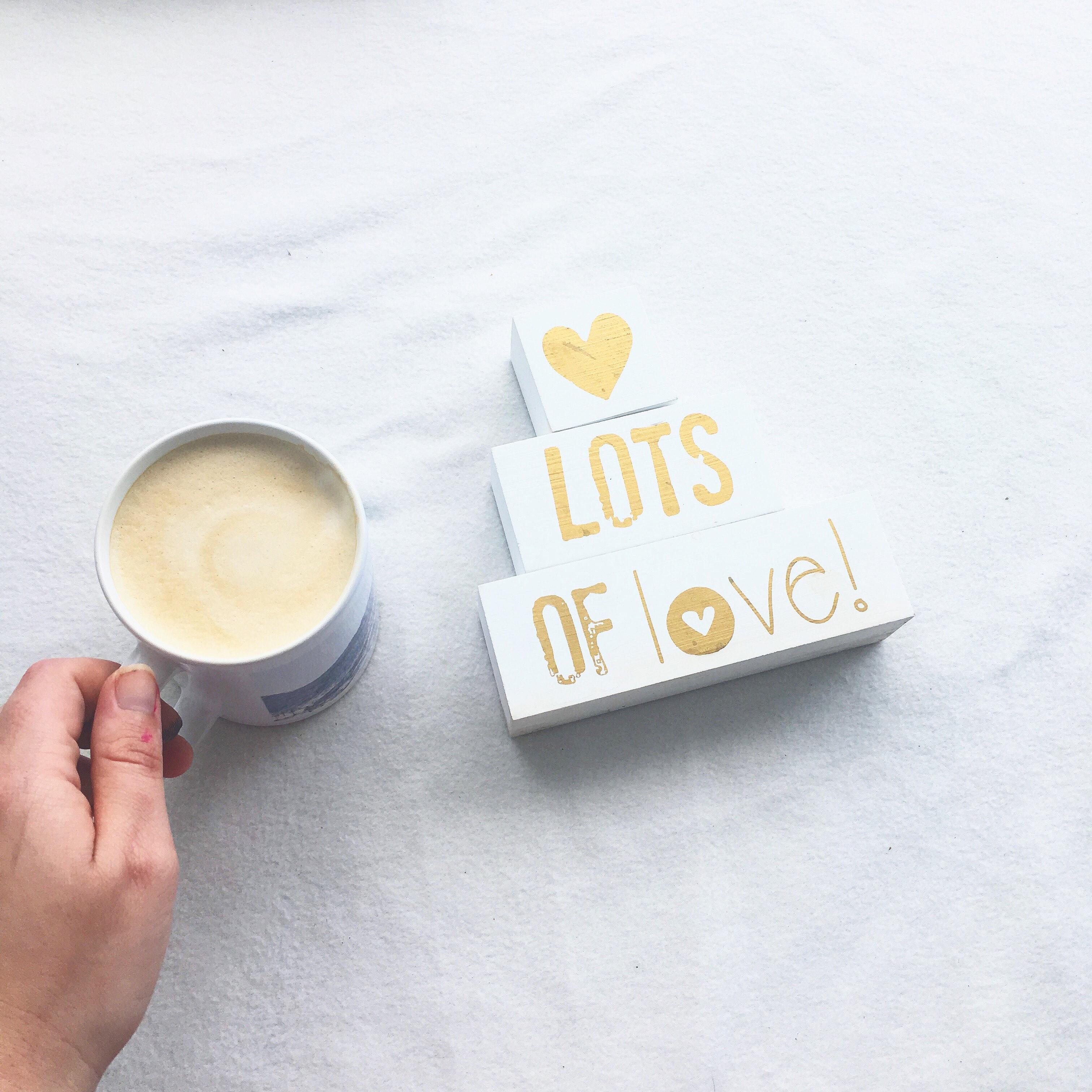 Person holding white ceramic coffee mug photo