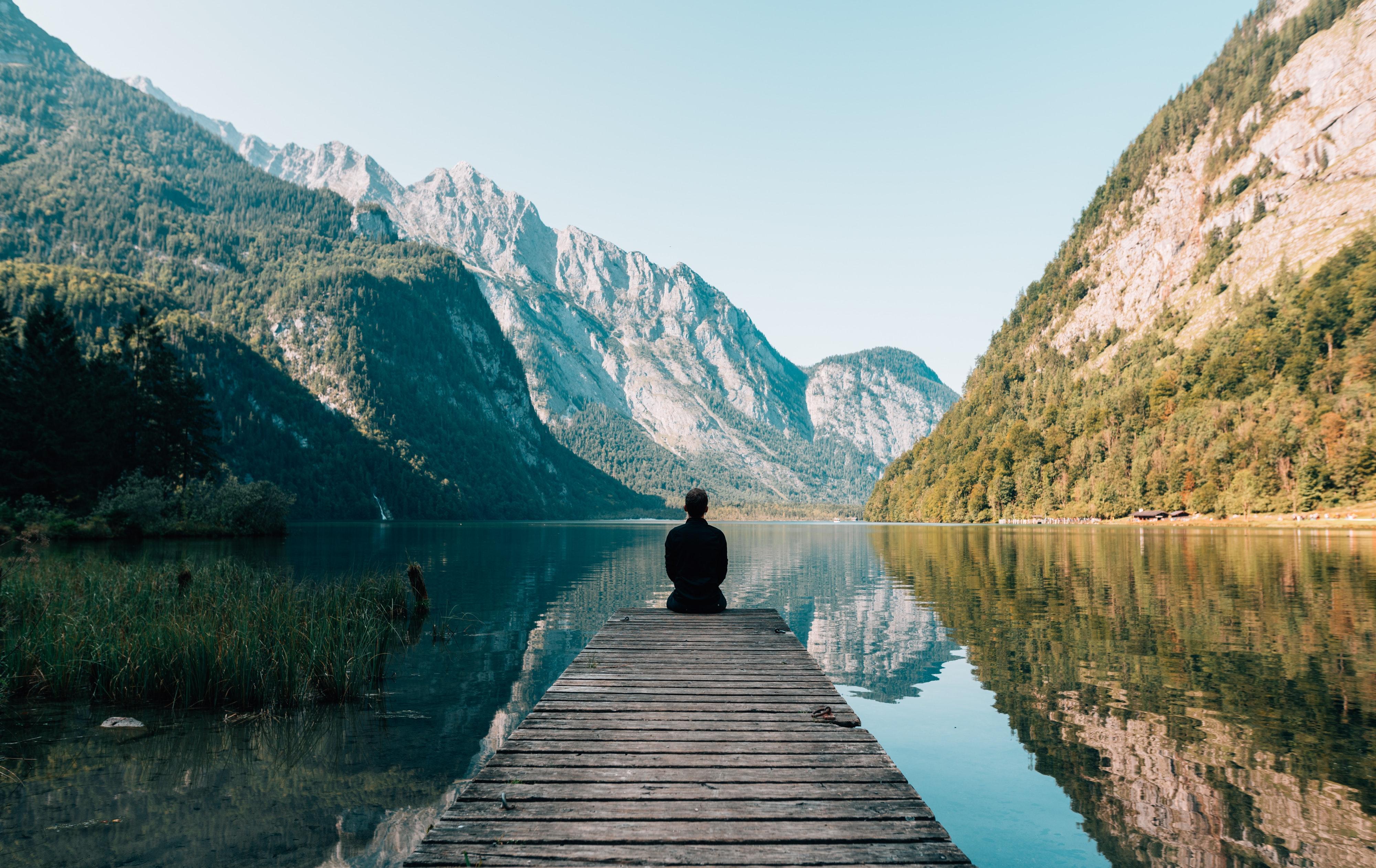 Person on a bridge near a lake photo