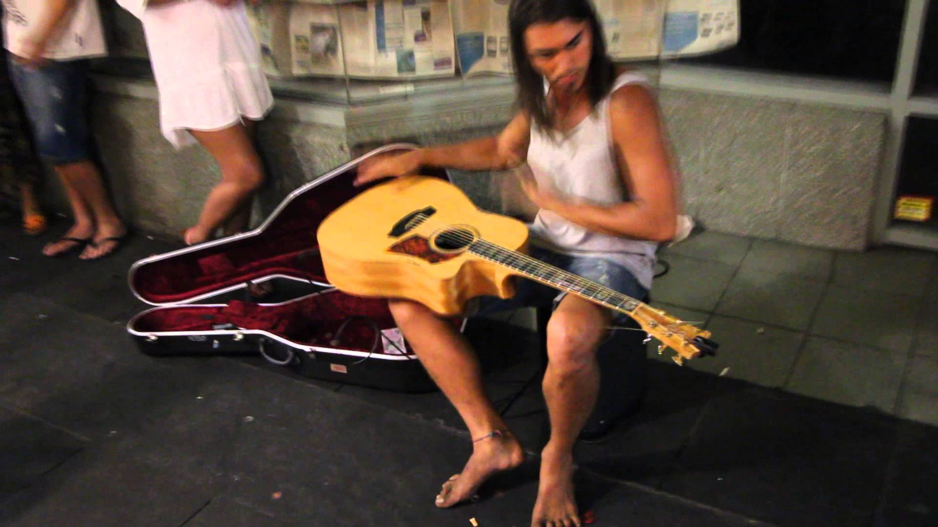 Person playing guitar on street photo