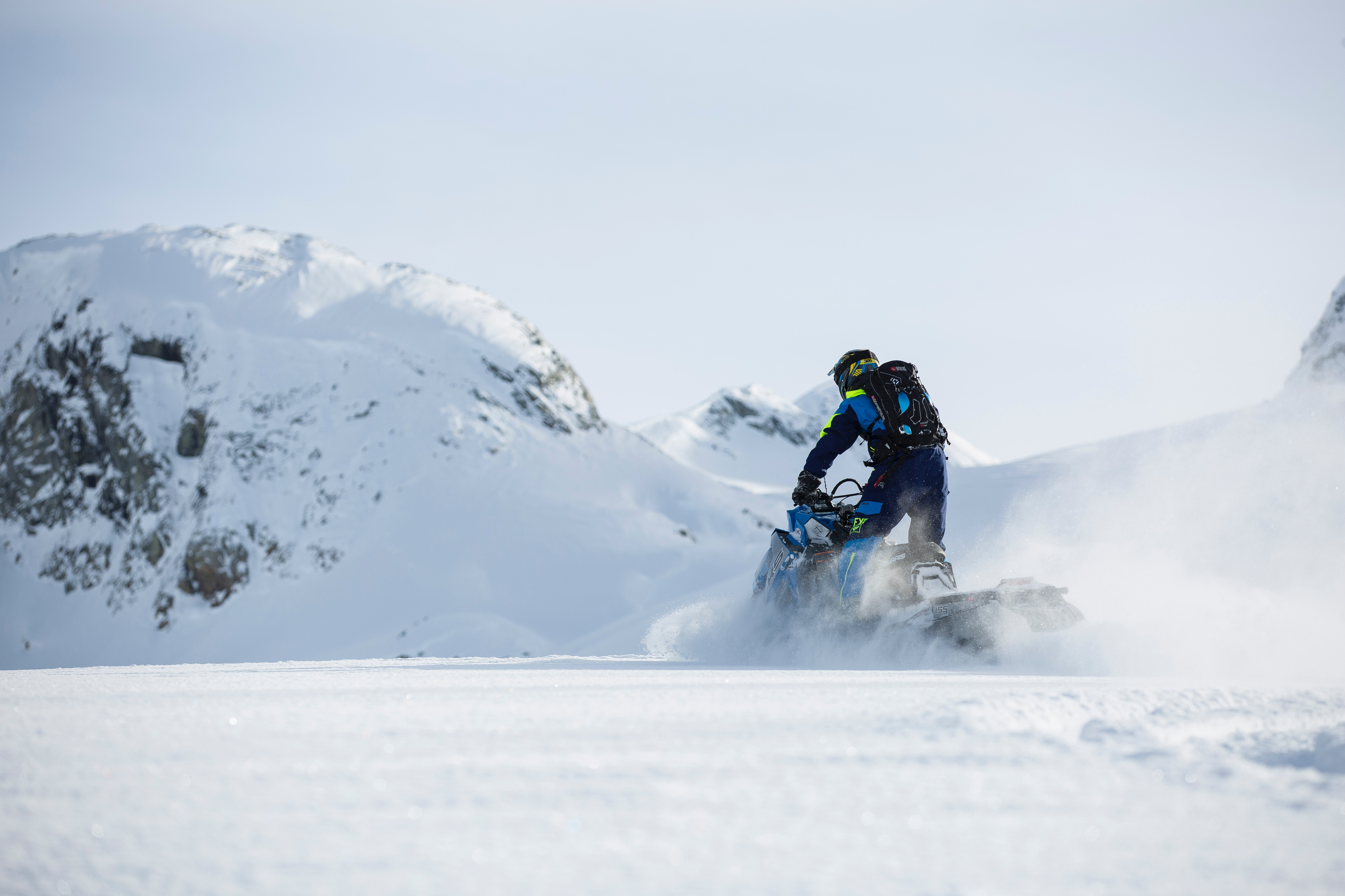 Person riding on snowmobile during winter photo