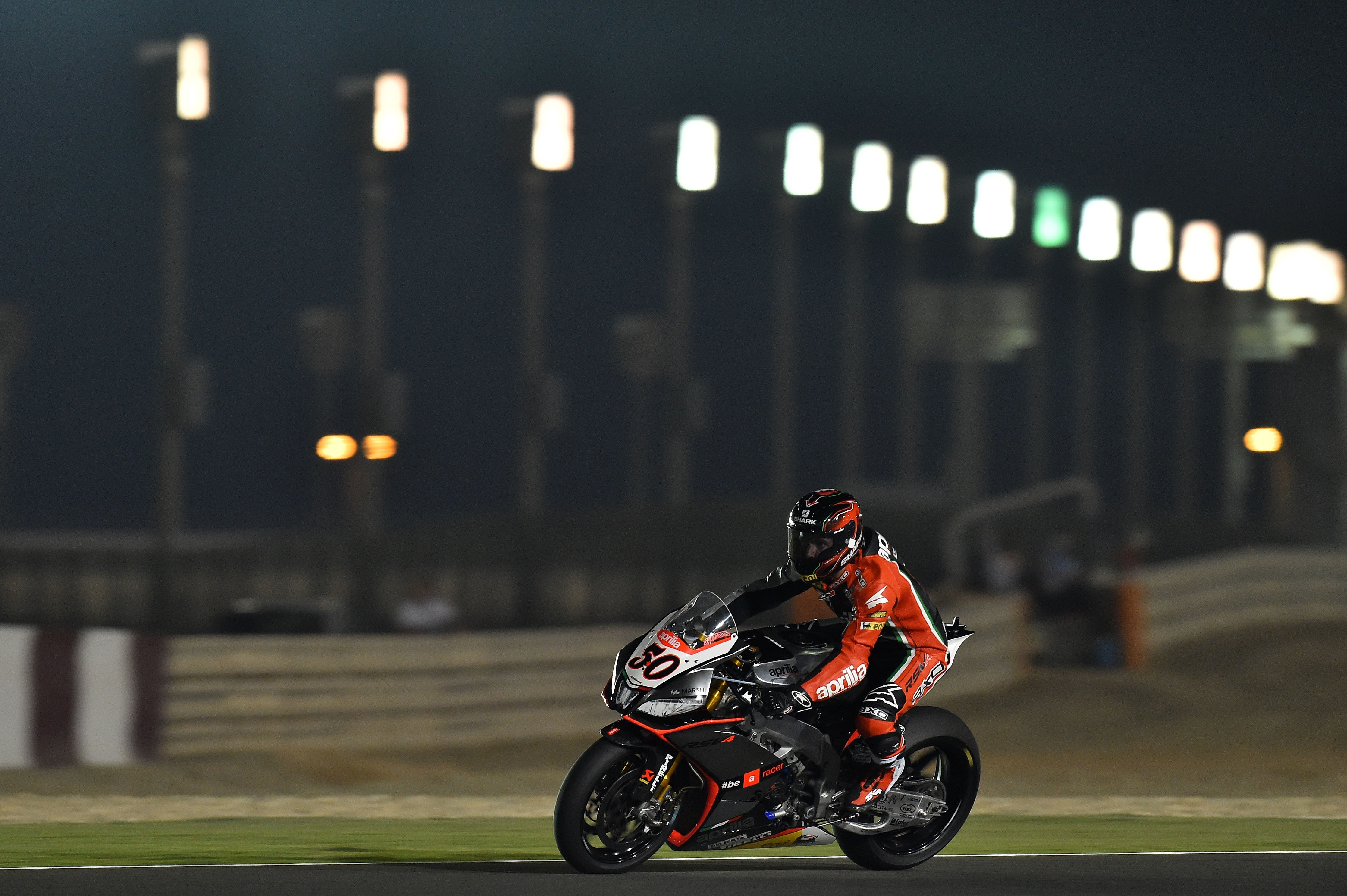 Person riding super bike during night race photo