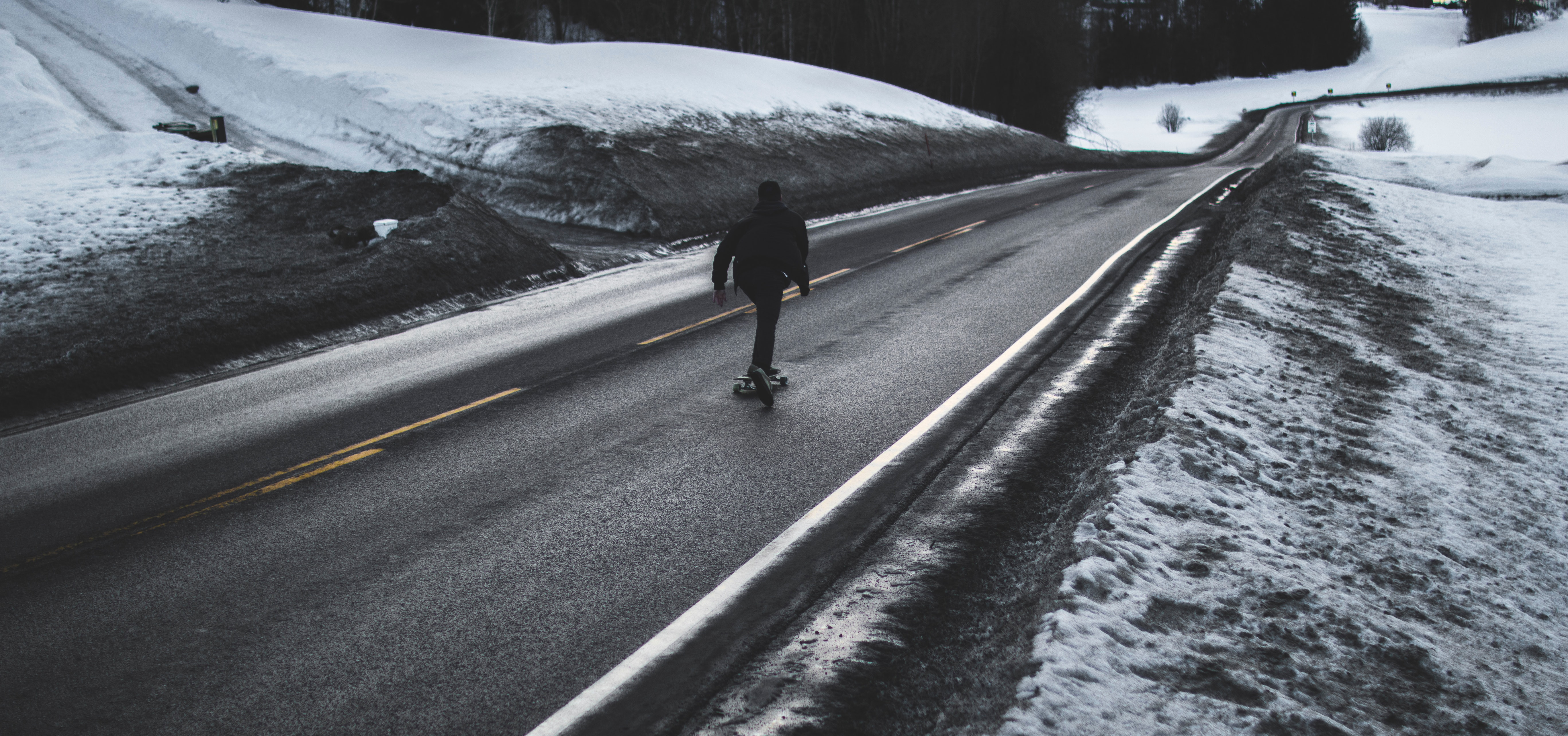 Person running on asphalt road photo