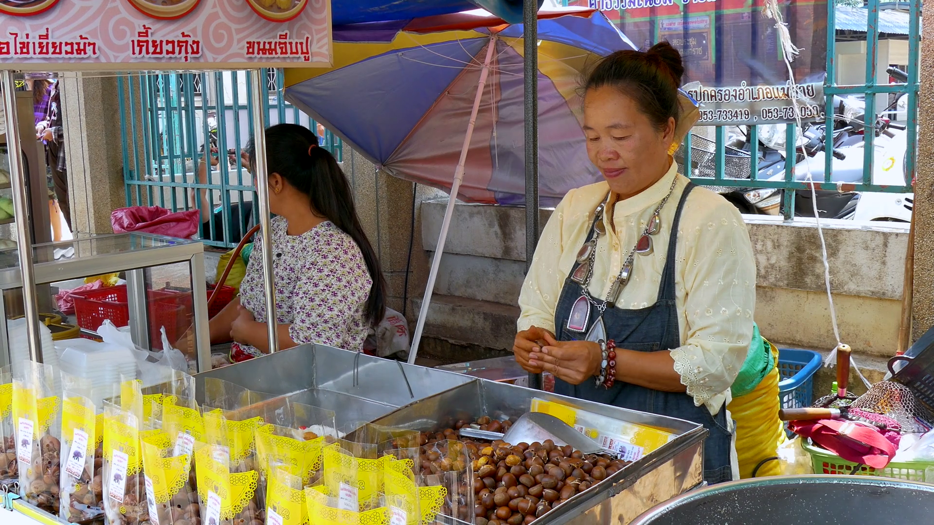 Woman sells Sweet Chestnuts at Market in Mae Sai, the northernmost ...