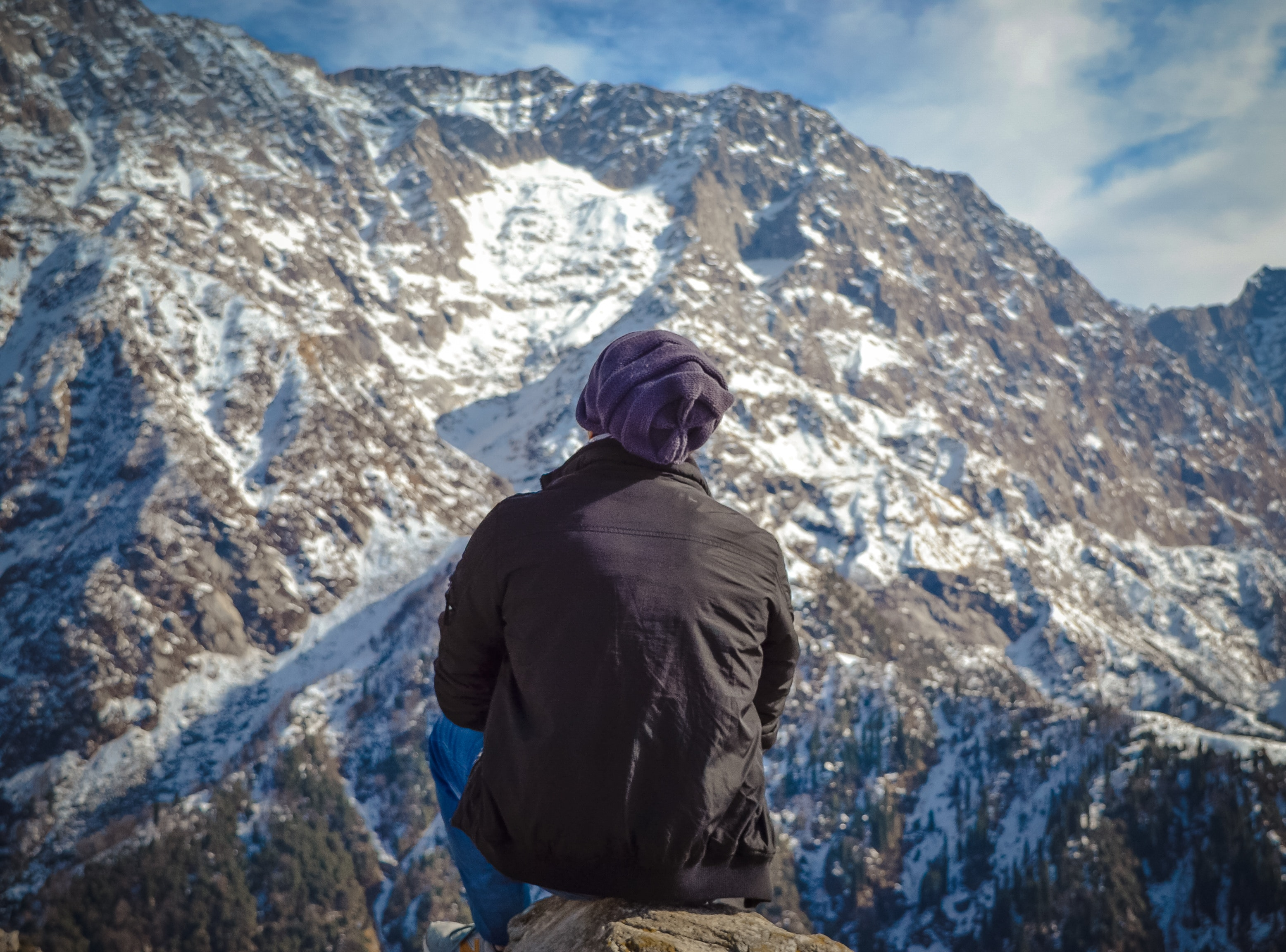 Person sitting on hill photo