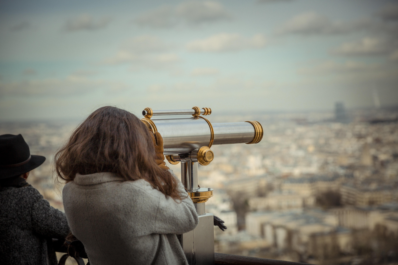 Person using telescope photo