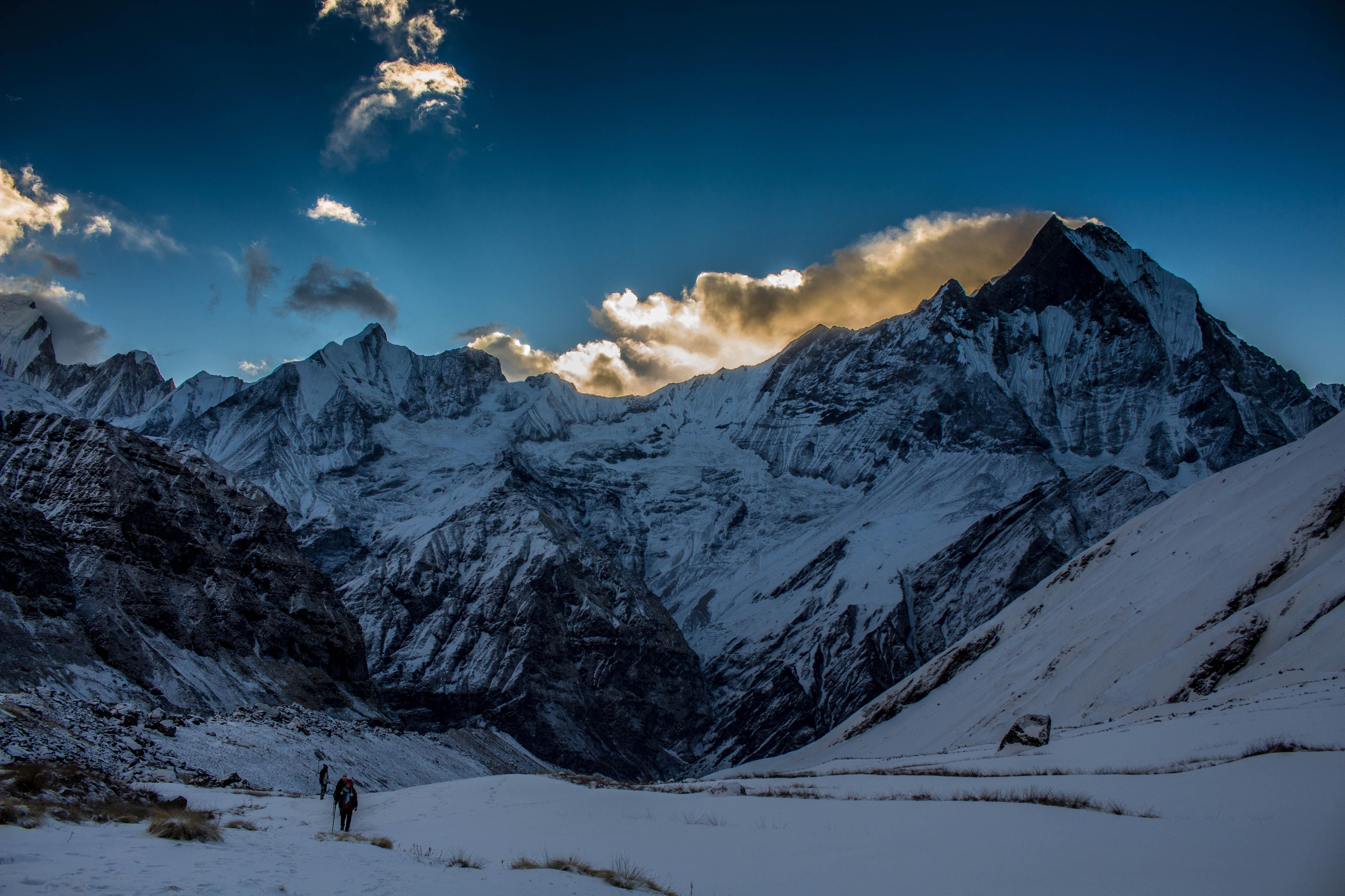 Person walking in snow mountain photo