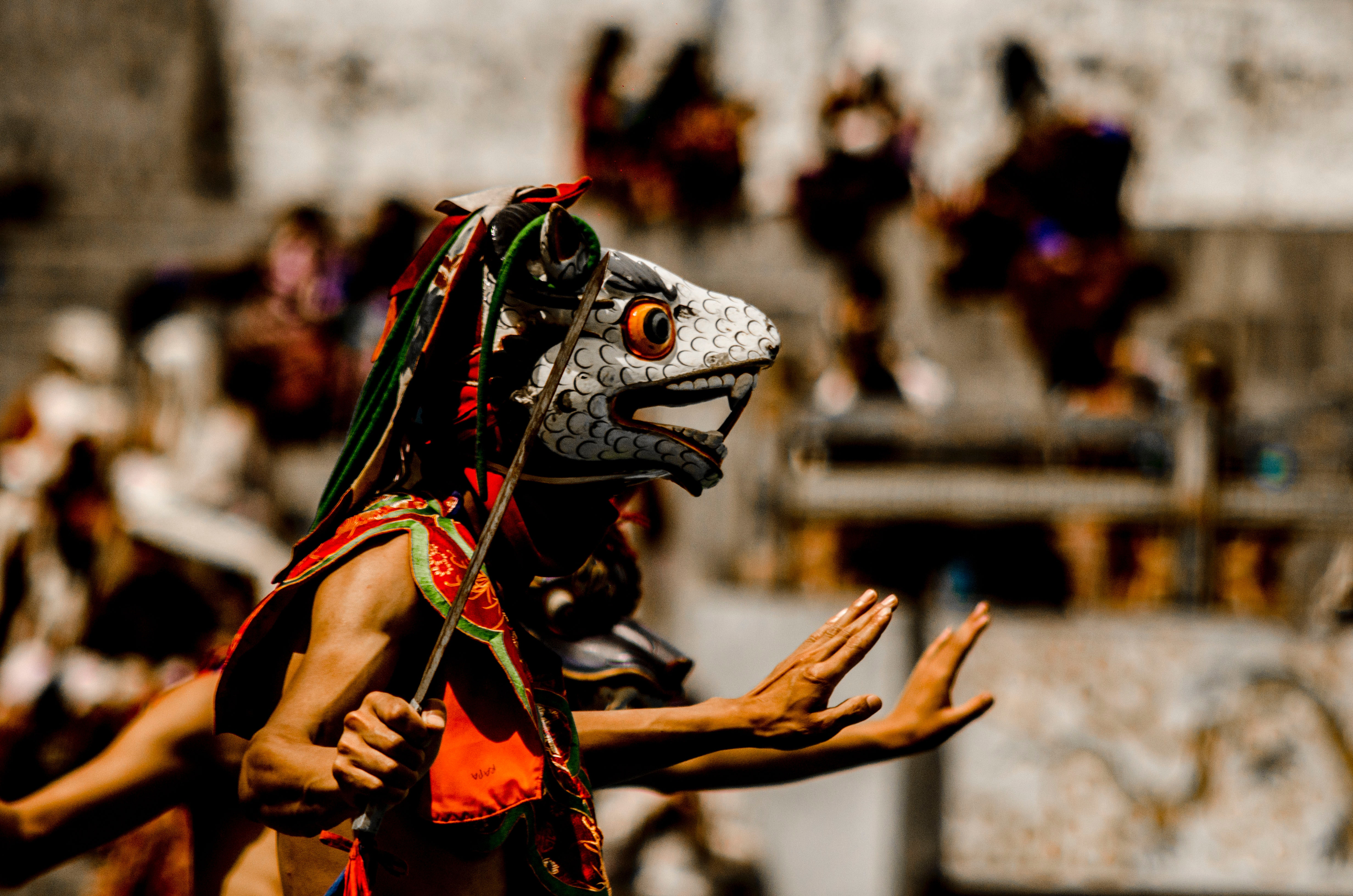 Person wearing traditional mask dancing photo