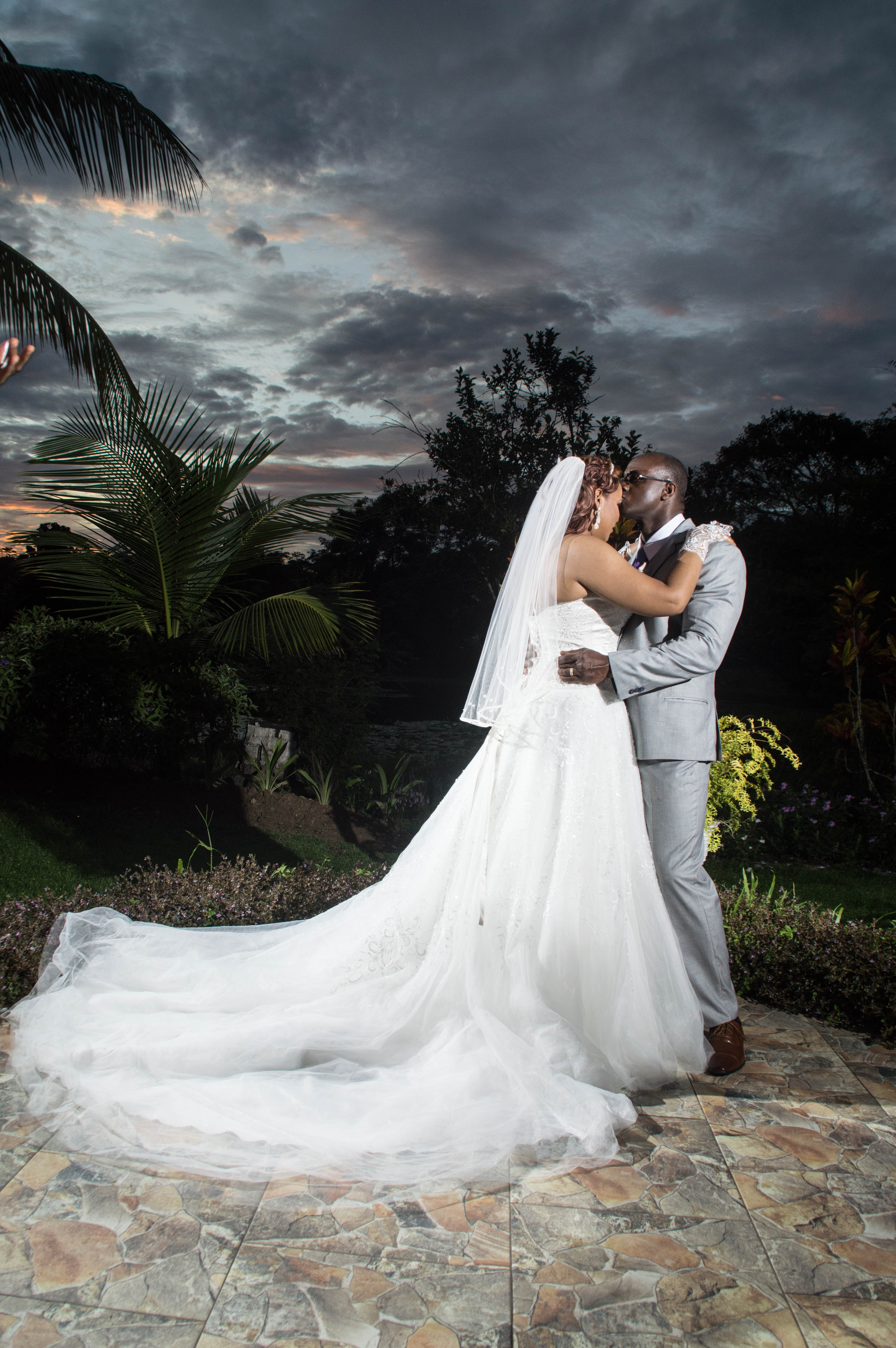 Photo of a Man Kissing His Wife, Togetherness, Photoshoot, Plants, Romance, HQ Photo
