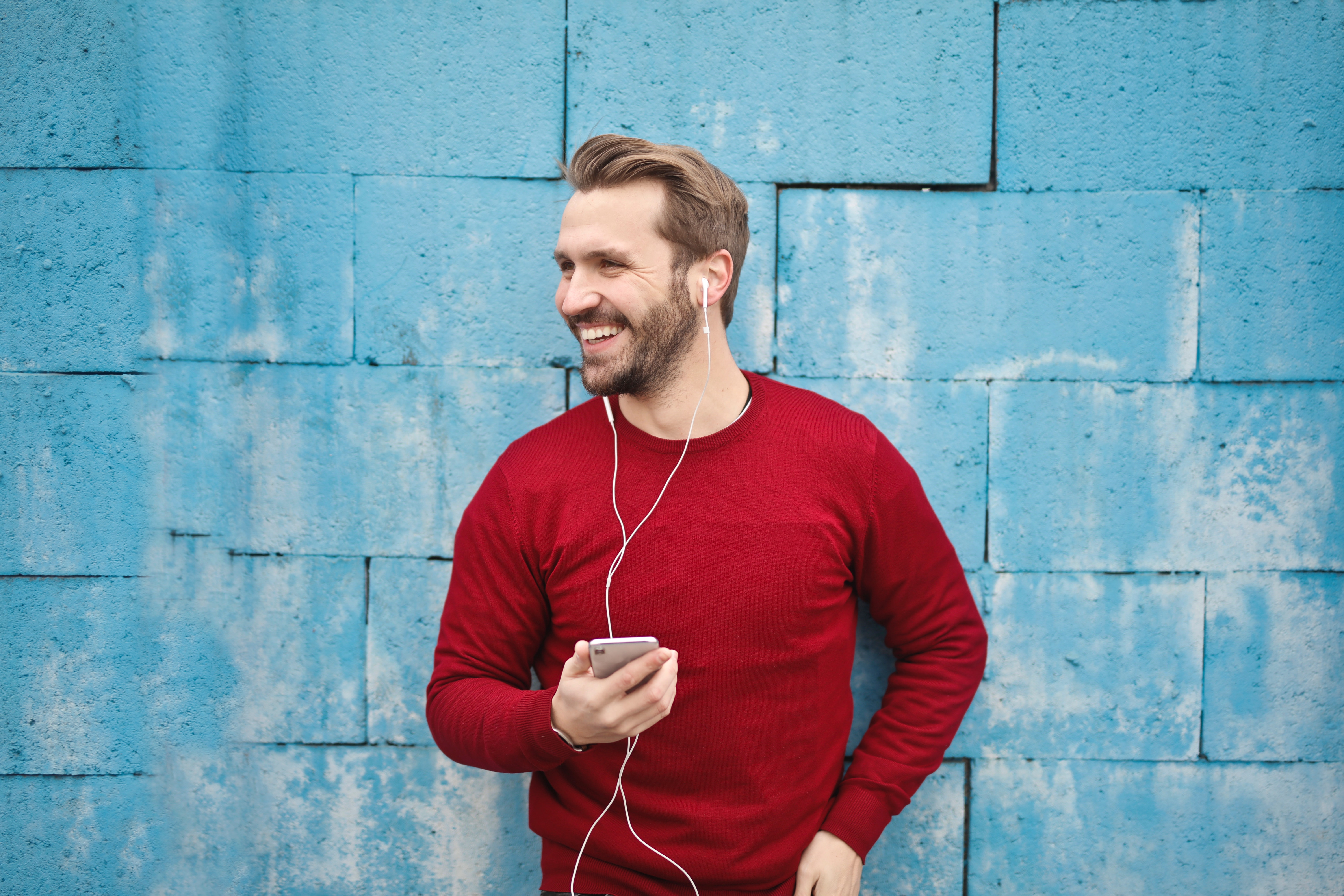 Photo of a Man Listening Music on his Phone, Adult, Man, Wall, Urban, HQ Photo