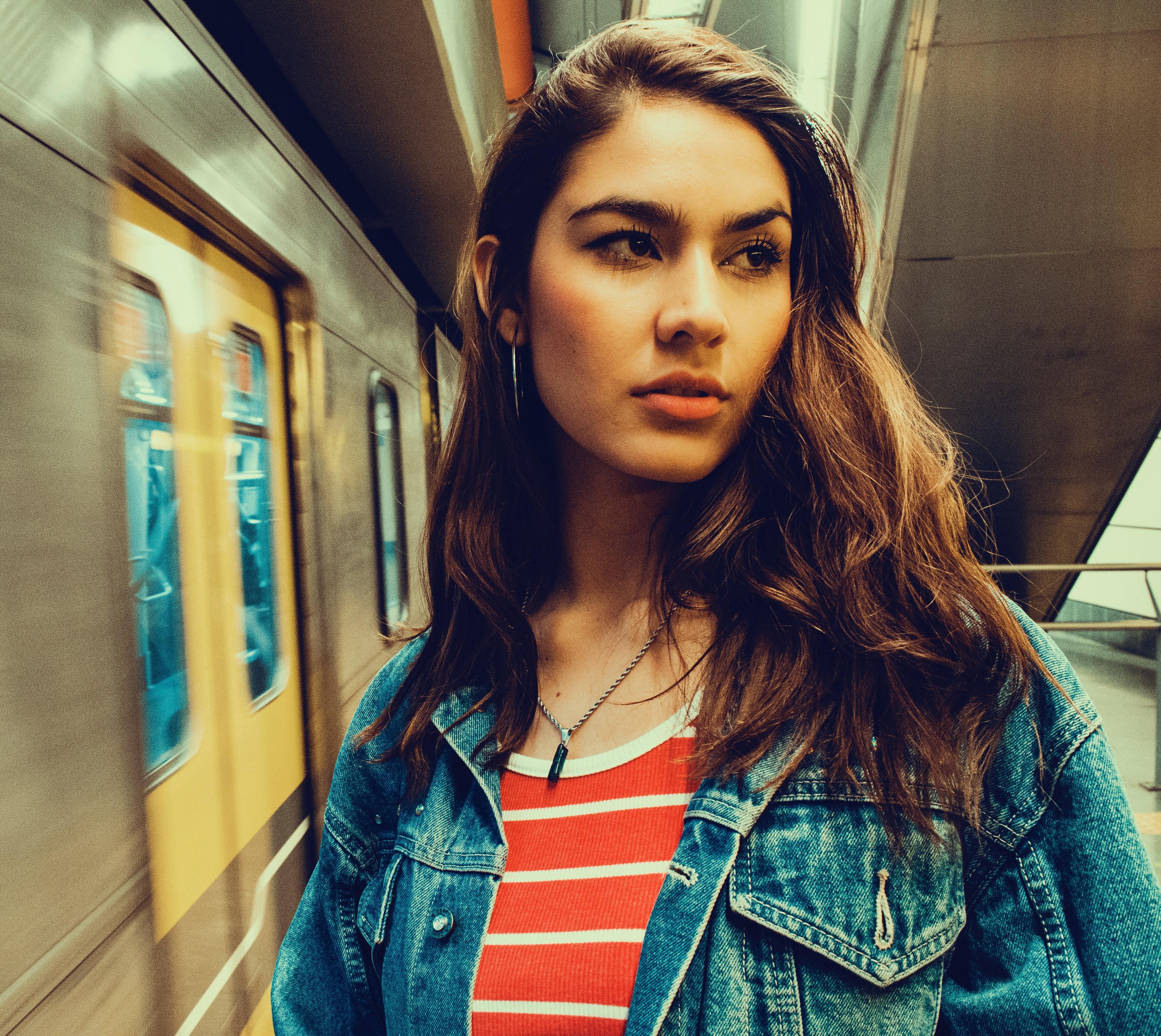 Photo of a woman wearing blue denim jacket