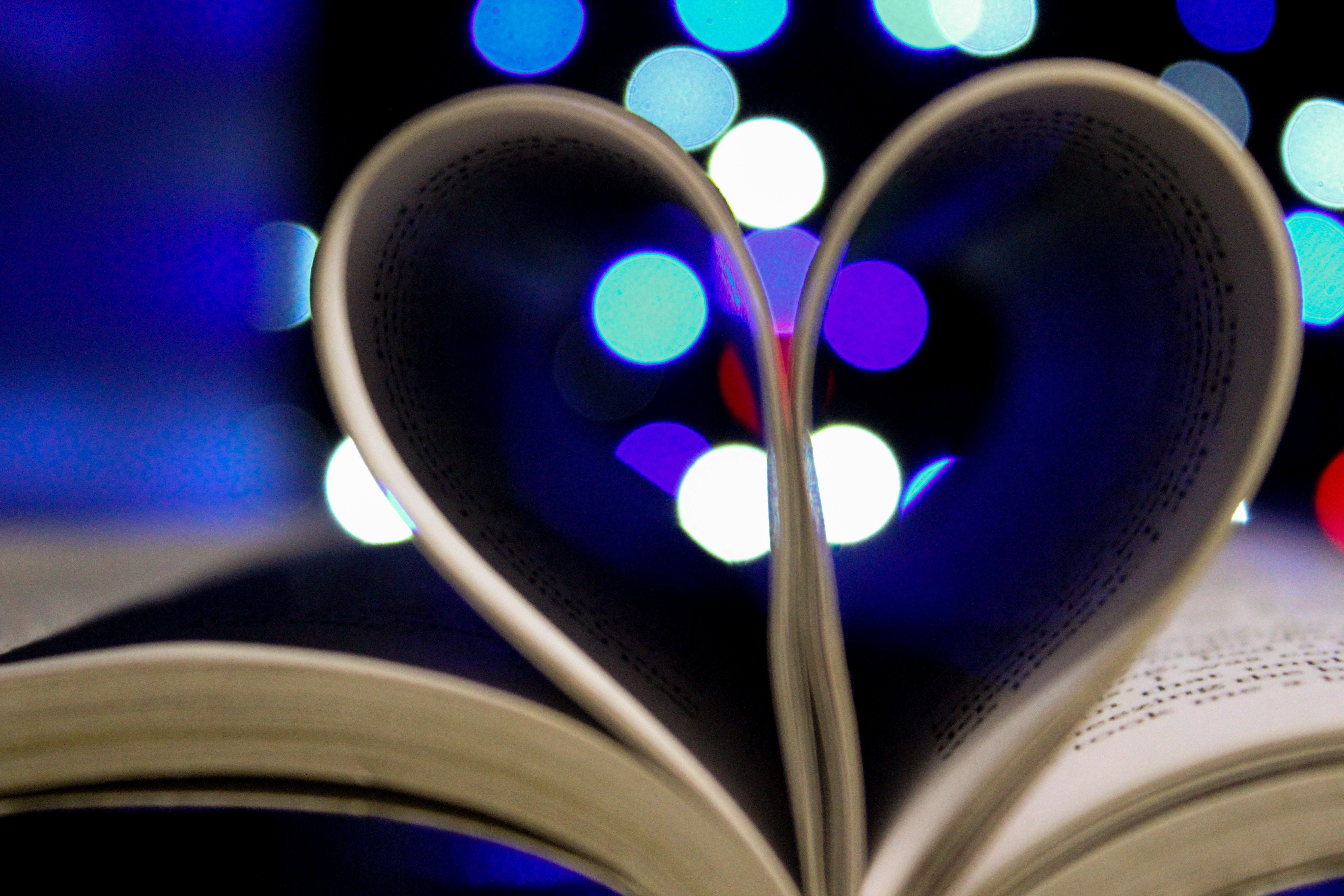 Photo of Bookpages Folded Into Heart Shape With Bokeh Light Background, Abstract, Design, Love, Light, HQ Photo